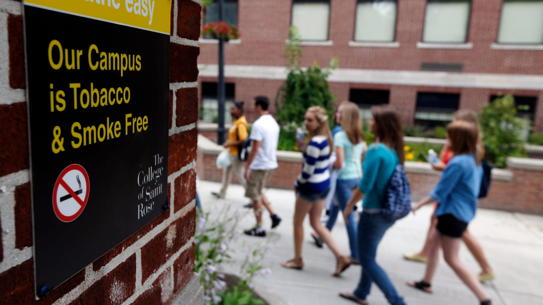 June 26, 2012: Students take an orientation tour at the College of Saint Rose in Albany, N.Y. Tobacco use bans are sweeping campuses nationwide.