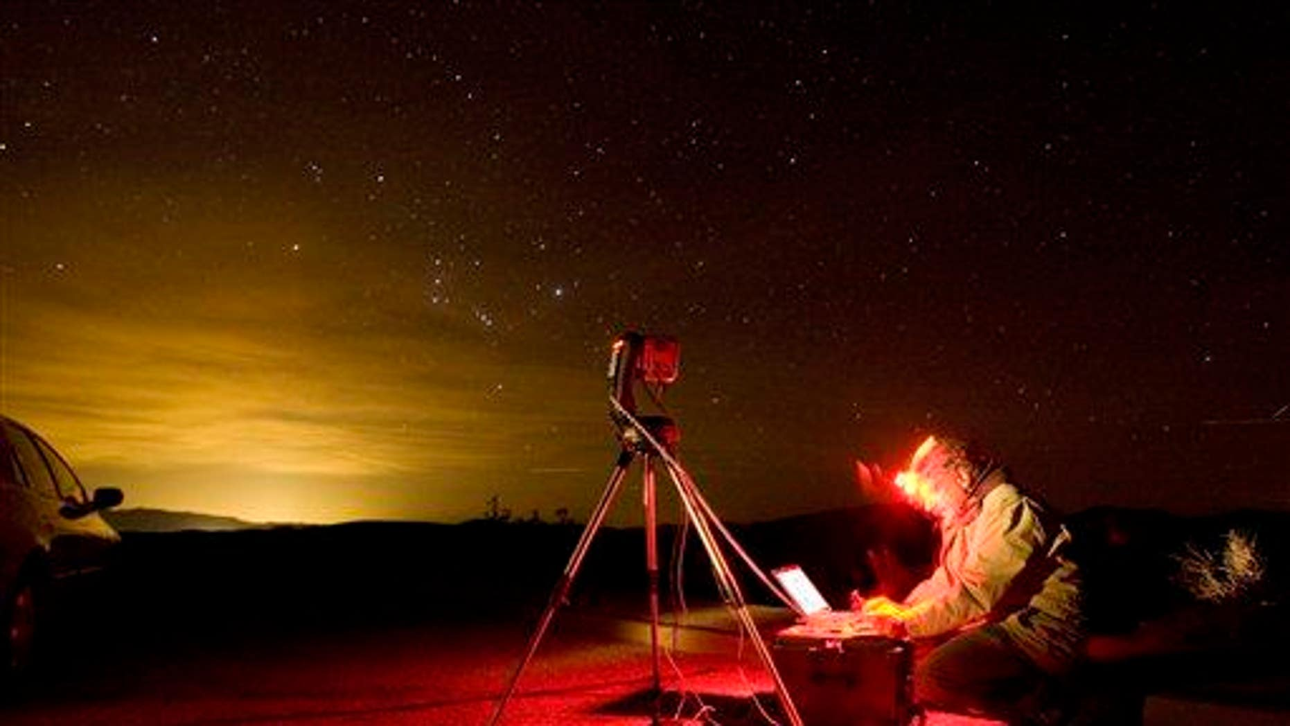 A photographer snaps the night sky with a special computer controlled camera in Death Valley National Park, Calif.
