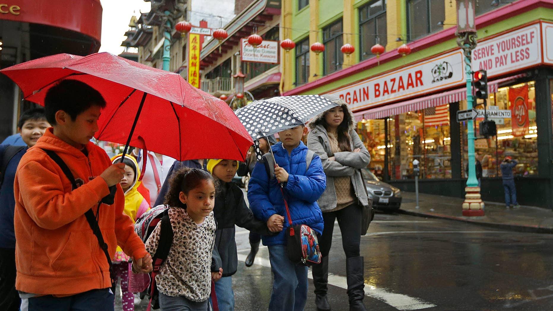 Feb. 6, 2015: Children from San Francisco Community School walk through Chinatown while on a field trip.