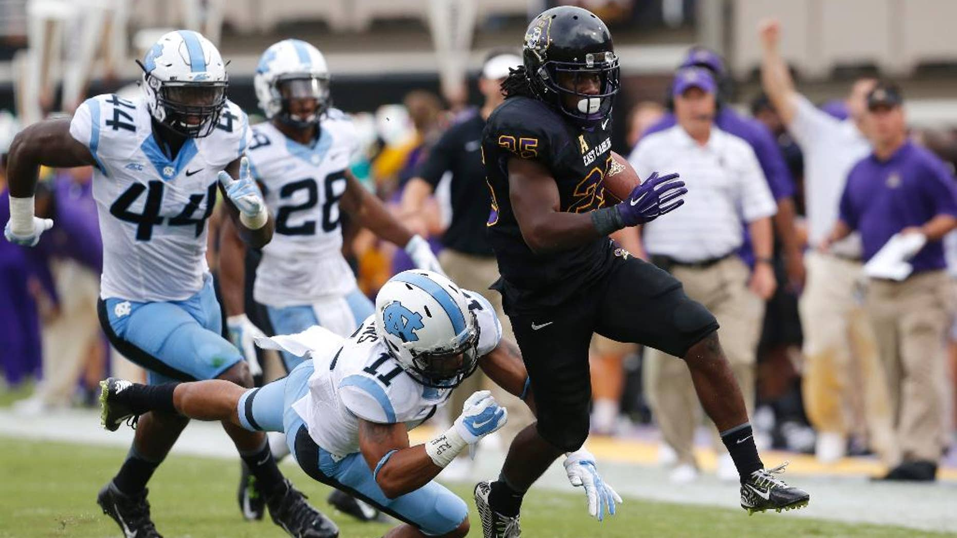 FILE - In this Sept. 20, 2014, file photo, East Carolina running back Breon Allen (25) beats North Carolina's Malik Simmons while scoring a 44-yard touchdown during the first half of their NCAA college football game at Dowdy-Ficklen Stadium in Greenville, N.C. Allen turned in a huge rushing day in the win that pushed East Carolina into the national rankings. Allen's emergence could help replace the rushing production lost from last season for the No. 22 Pirates, who make their American Athletic Conference debut Saturda, Oct. 4, 2014,  against SMU.  (AP Photo/The News & Observer, Ethan Hyman, File)