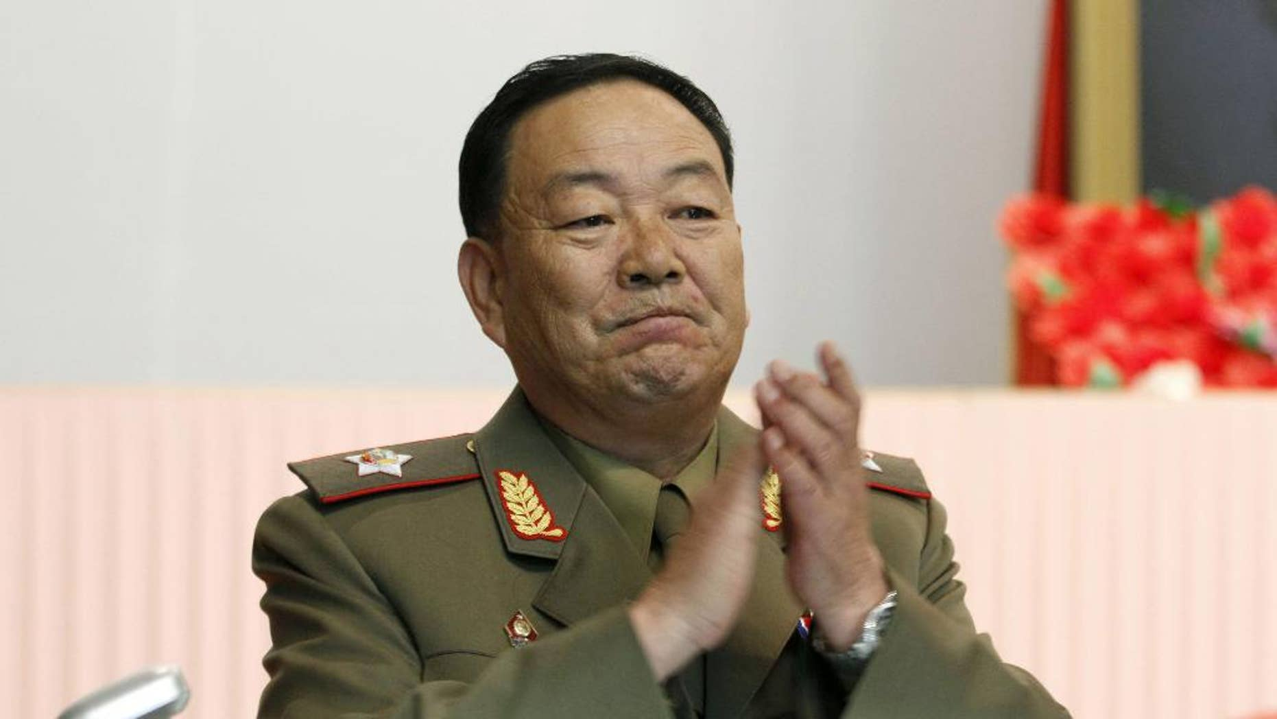 FILE - In this July 18, 2012, file photo, then Vice Marshal Hyon Yong Chol applauds during a meeting in Pyongyang, North Korea. North Korean leader Kim Jong Un ordered his defense chief Hyon Yong Chol executed with an anti-aircraft gun for complaining about the young ruler, talking back to him and sleeping during a meeting presided over by Kim, South Korea's spy agency told lawmakers Wednesday, May 13, 2015, citing what it called credible information. (AP Photo/Jon Chol Jin, File)