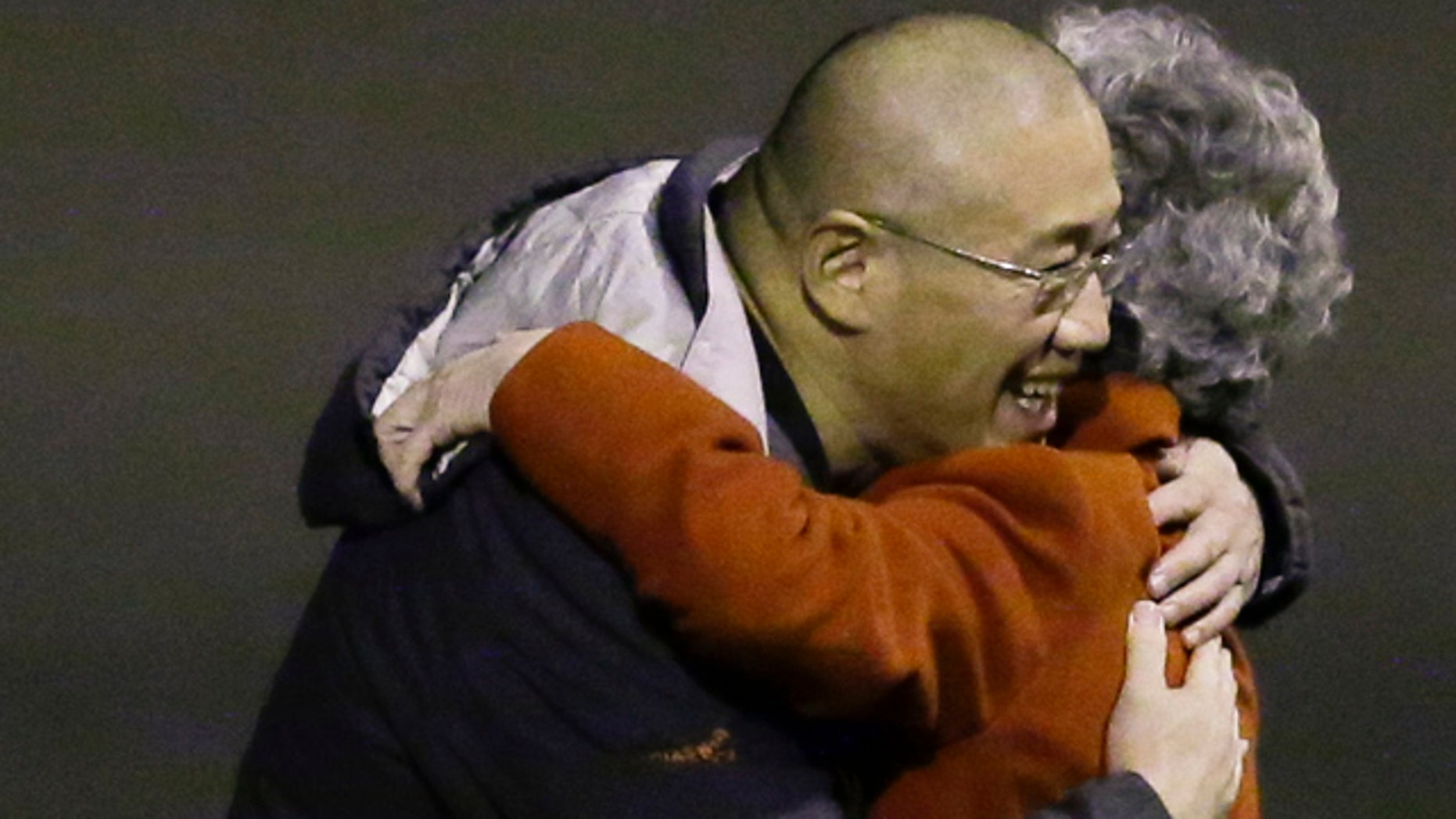 November 8, 2014: Kenneth Bae, left, who had been held in North Korea since 2012, hugs his mother Myunghee Bae after arriving at Joint Base Lewis-McChord, Wash., after being freed during a top-secret mission by James Clapper, U.S. director of national intelligence. (AP Photo/Ted S. Warren)