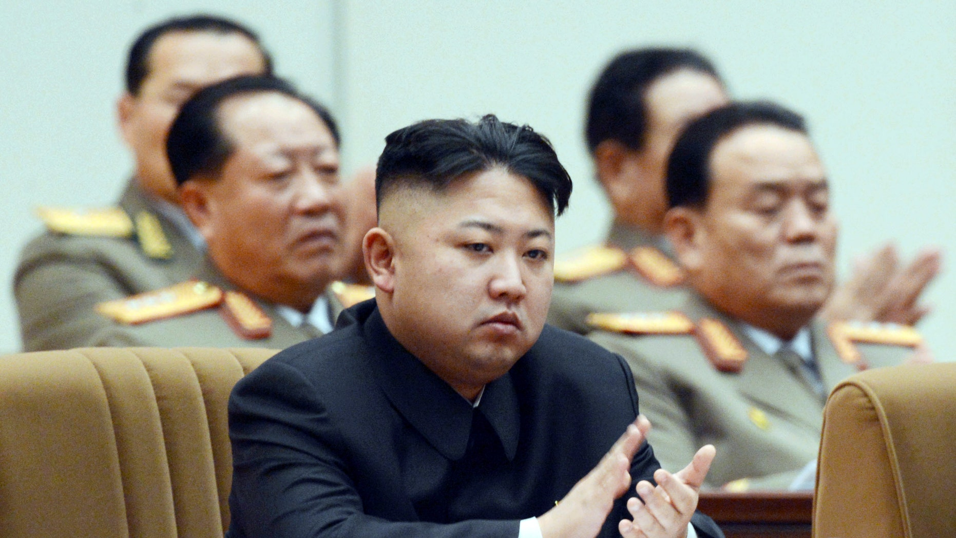 North Korean leader Kim Jong Un claps his hands as he attends a national memorial service on the eve of the anniversary of Kim Jong Il's death in Pyongyang, North Korea, Sunday, Dec. 16, 2012. (AP Photo/Kyodo News) JAPAN OUT, MANDATORY CREDIT, NO LICENSING IN CHINA, HONG KONG, JAPAN, SOUTH KOREA AND FRANCE