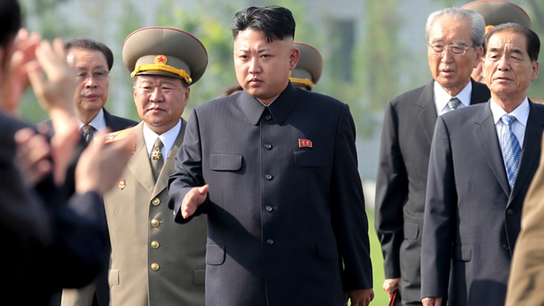 FILE - In this July 25, 2013 file photo, North Korean leader Kim Jong Un, center, arrives at the cemeteries of fallen fighters of the Korean People's Army Pyongyang. (AP Photo/Wong Maye-E, File)