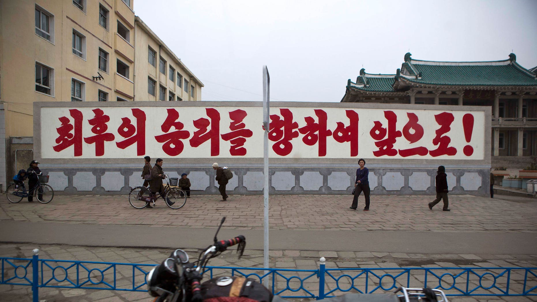 """April 23, 2013: A propaganda billboard, which reads """"Forward to the Ultimate Victory"""" in Korean stands in central Kaesong, North Korea. For weeks, North Korea has threatened to attack the U.S. and South Korea for holding joint military drills and for supporting U.N. sanctions. Washington and Seoul said they've seen no evidence that Pyongyang is actually preparing for a major conflict, though South Korean defense officials said the North appears prepared to test-fire a medium-range missile."""