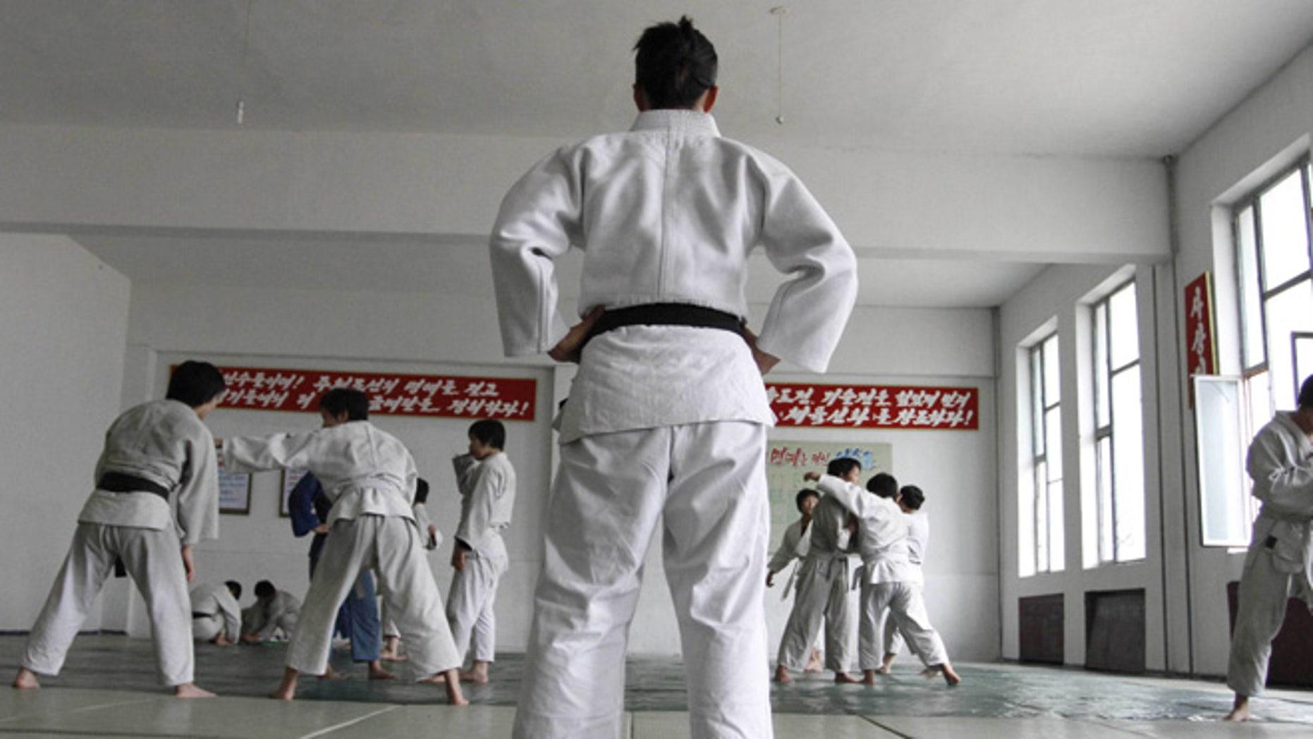 June 22, 2012: In this photo, North Korean judo coach Kye Sun Hui, center, trains players in Pyongyang, North Korea.