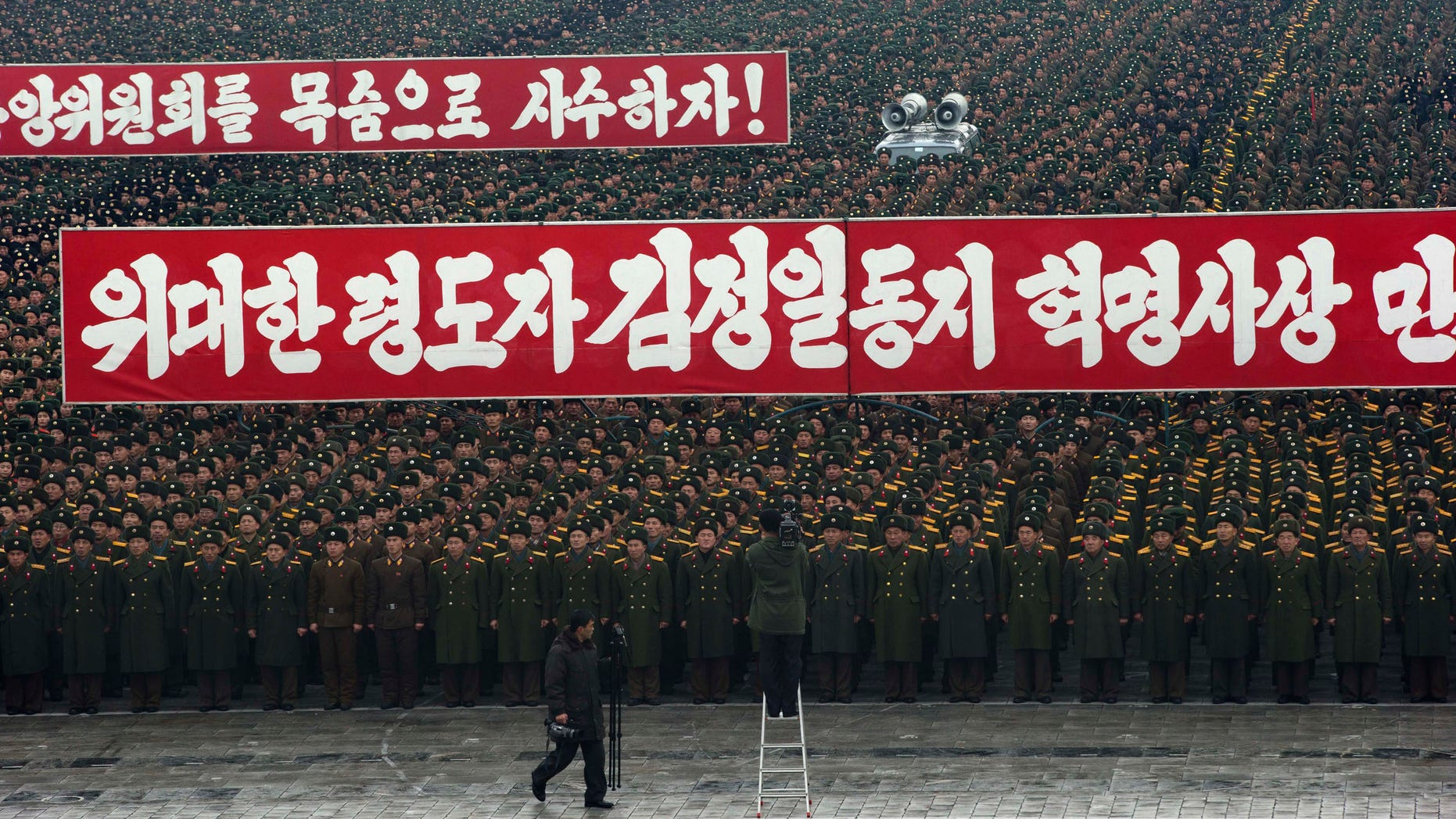 Dec. 14, 2012 - Slogans honoring the leadership during a mass rally organized to celebrate the success of a rocket launch that sent a satellite into space on Kim Il Sung Square in Pyongyang, North Korea.