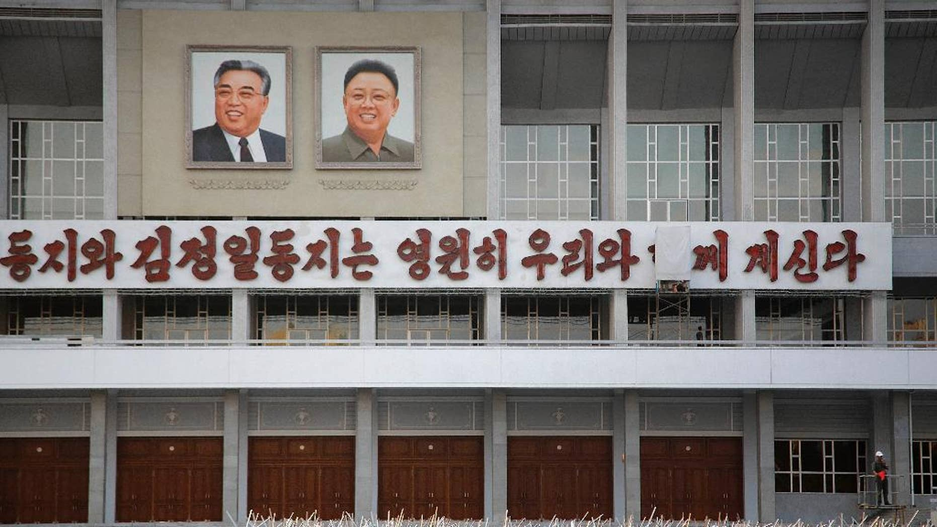 In this Tuesday, Sept. 15, 2015, photo, North Koreans gather in to prepare for events to be held during the 70th anniversary of the founding of their country's ruling party in October, in Pyongyang, North Korea. North Korea is already in high gear as it prepares to mark the 70th anniversary of the founding of its ruling party. Students and workers are being mobilized by the thousands to practice their parts in the grand show - some carrying wooden torches, others bouquets of red plastic flowers. (AP Photo/Wong Maye-E)