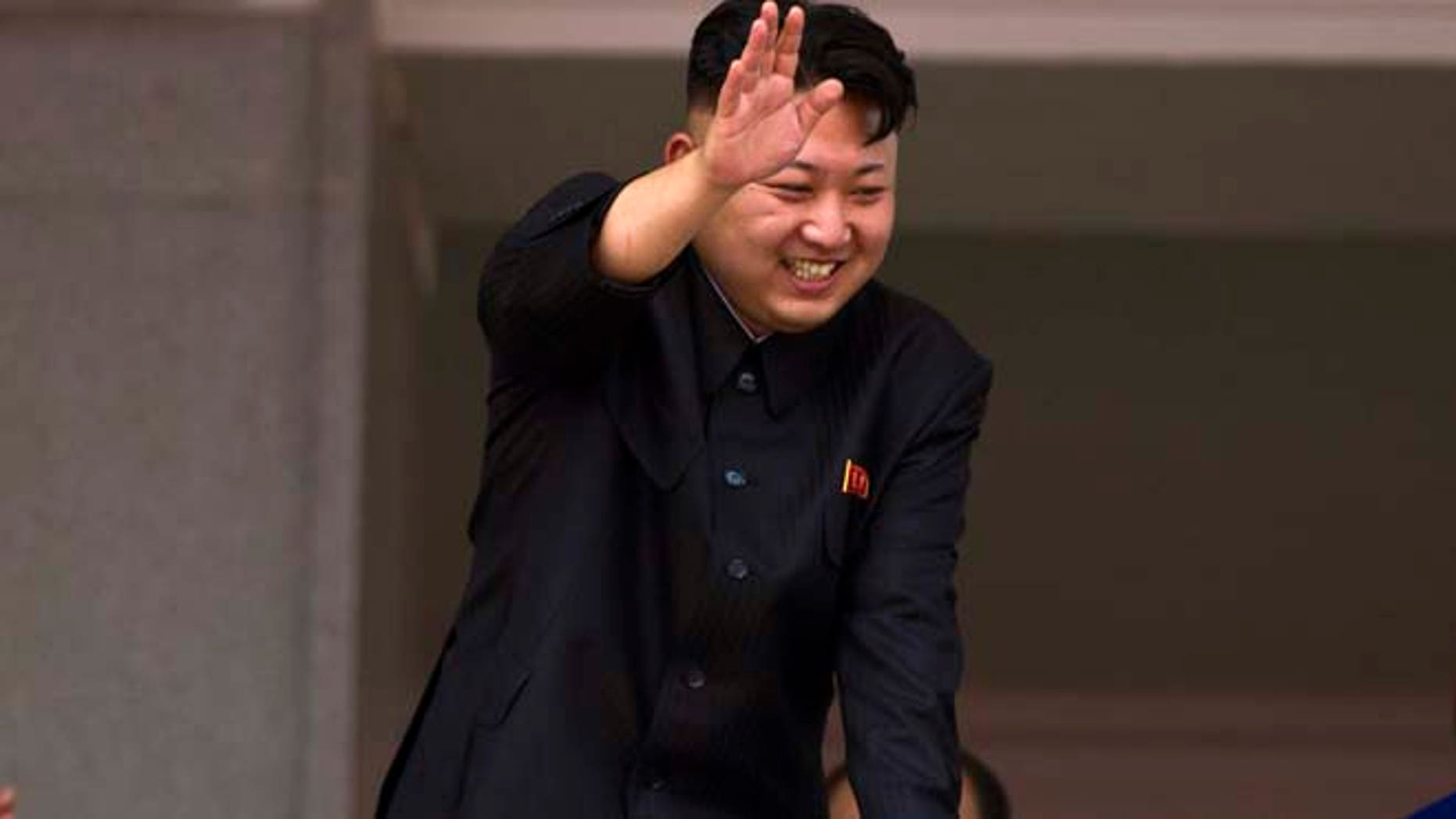 July 27, 2013: In this file photo, North Korean leader Kim Jong Un leans over a balcony and waves to Korean War veterans cheering below at the end of a mass military parade on Kim Il Sung Square in Pyongyang to mark the 60th anniversary of the Korean War armistice. (AP)