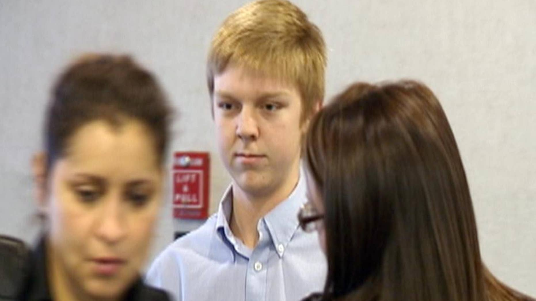 FILE - This Dec. 2013 file image taken from a video by KDFW-FOX 4, Ethan Couch, who killed four people in a drunken wreck in 2013, appears for his court hearing in Fort Worth, Texas. Couch's family has settled with some, but not all, of the victims suing them. Court records indicate the family has settled three lawsuits brought against them, including suits involving three of the four people who died. But at least four other lawsuits have not been settled.  (AP Photo/KDFW-FOX 4, File)