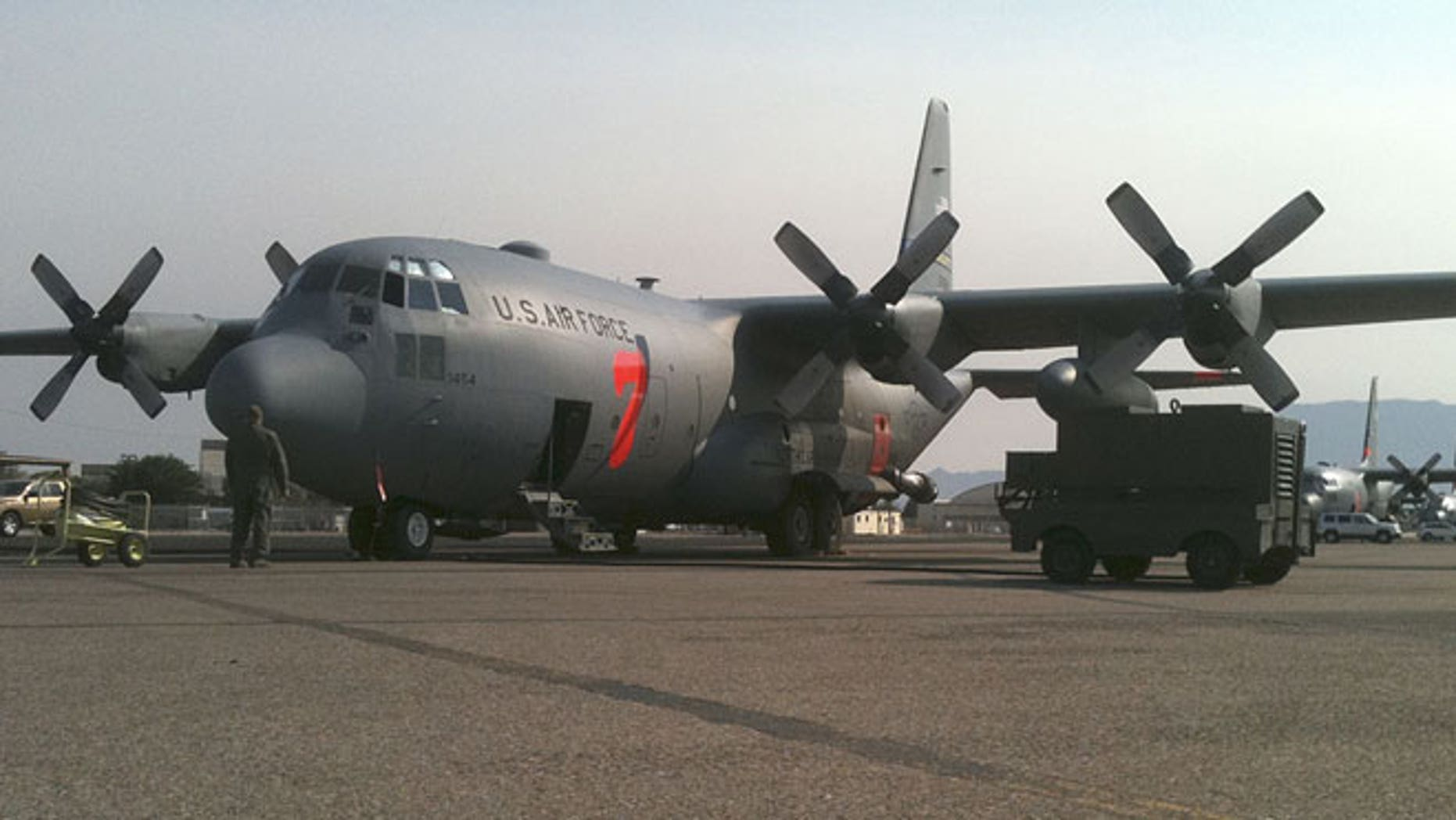In this July 2, 2011 photo provided by the North Carolina National Guard, a crew prepares a C-130 MAFFS 7 (Modular Airborne FireFighting System) cargo plane to battle a wildfire, in Albuquerque, New Mexico.