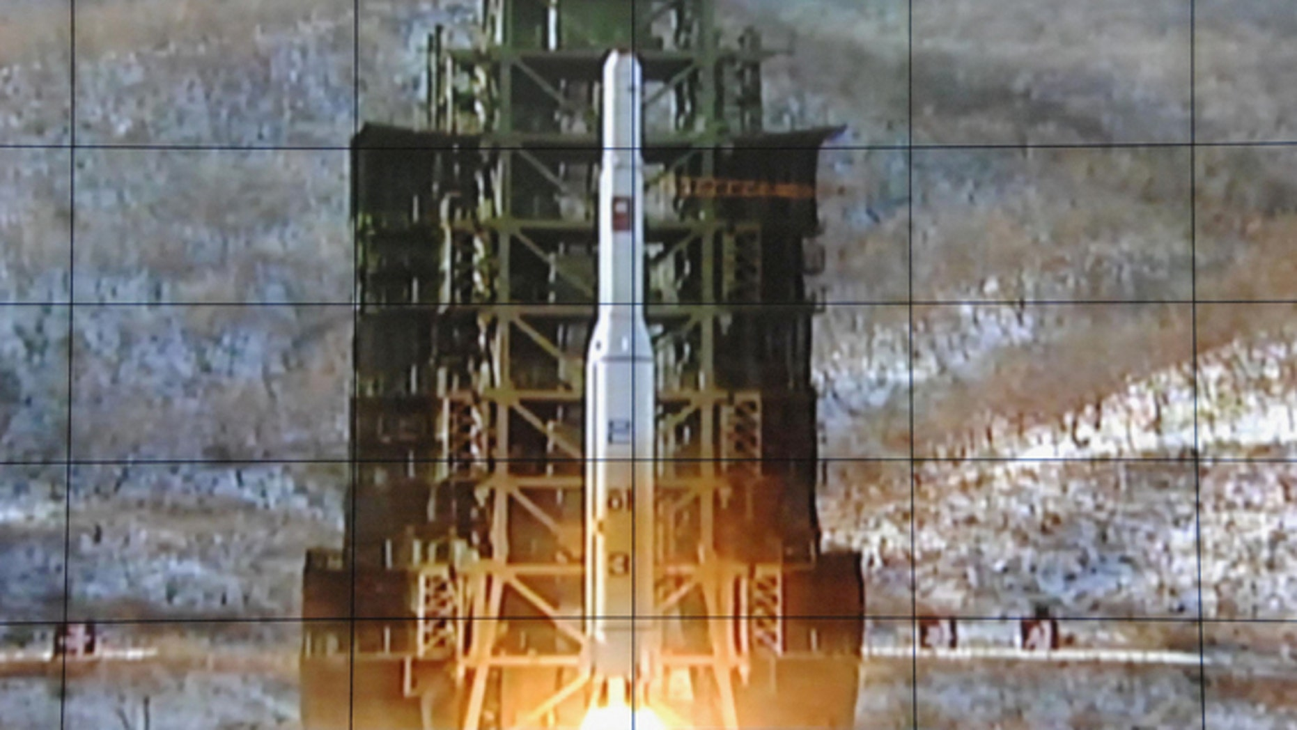 Dec. 12, 2012: A screen shows a rocket being launched from a launch pad at the West Sea Satellite Launch Site, at North Korea's satellite control centre in Cholsan county, North Pyongan province, in this photo released by Kyodo News.