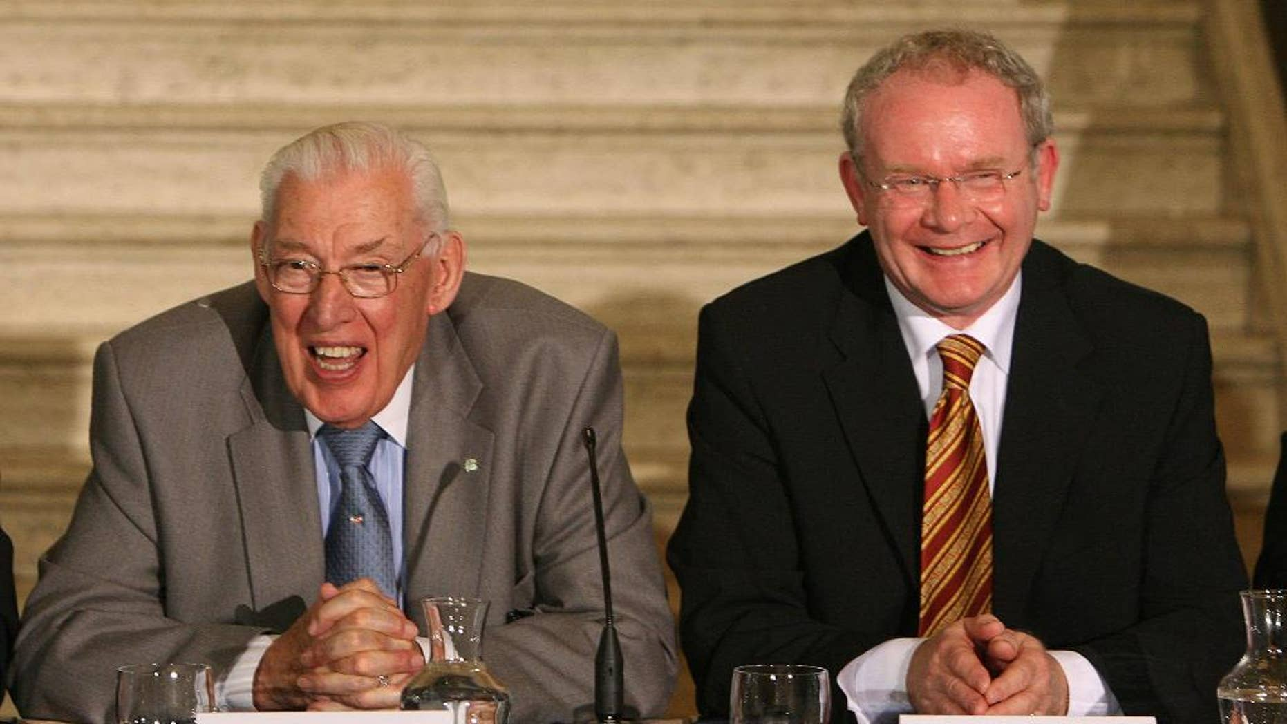 FILE - This is a Monday, July 16, 2007 file photo of Northern Ireland First Minister, Dr Ian Paisley, left, and Northern Ireland Deputy First Minister, Martin McGuinness, as they speak to the media  at Parliament Buildings, Stormont, Belfast, Northern Ireland.  Ian Paisley frequently divided Northern Ireland in life. But a memorial to the Protestant evangelist who made peace late in life with Catholics has united the British territory's leaders. Leading figures from across Britain and Ireland came together Sunday  Oct. 19, 2014 at the Ulster Hall in Belfast to eulogize Paisley, who died last month at age 88.  (AP Photo/Paul Faith, Pool)