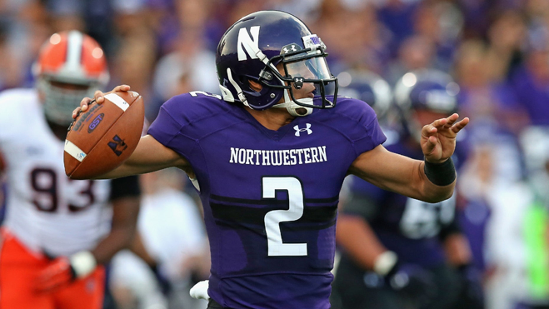 EVANSTON, IL - SEPTEMBER 07: Kain Colter #2 of the Northwestern Wildcats passes against the Syracuse Orange at Ryan Field on September 7, 2013 in Evanston, Illinois. (Photo by Jonathan Daniel/Getty Images)