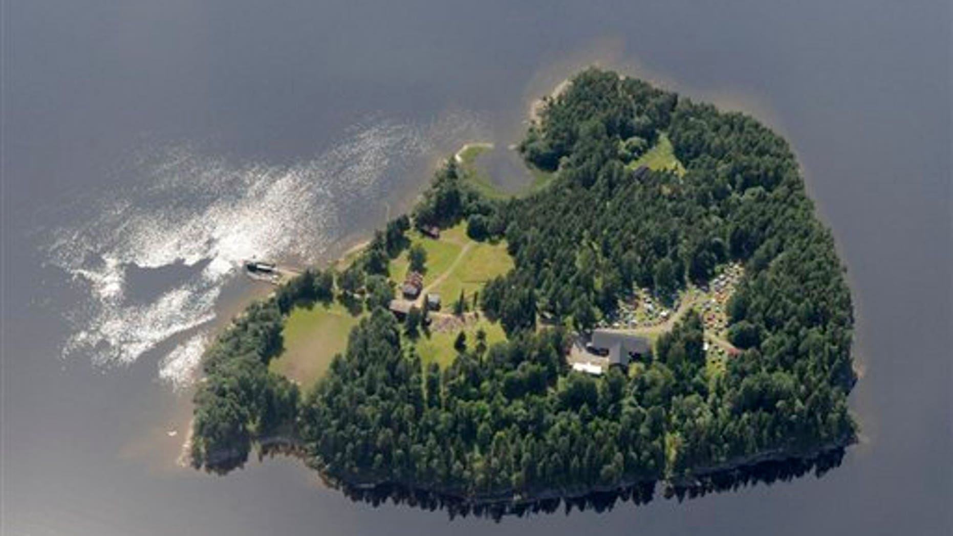 An aerial view of Utoya Island, Norway taken Thursday, July 21, 2011. Police say they are sending anti-terror police to a youth camp outside Oslo after reports of a shooting there following the bomb blast at the government headquarters. The news site VG reported that a man dressed in a police uniform opened fire at the camp. It says several people were injured. Oslo police chief Anstein Gjengdal said anti-terror units were being sent to the camp at Utoya, outside the Norwegian capital. He had no other information on that incident, which came hours after a bomb blast outside the government headquarters killed at least two people and injured 15. (AP Photo/Mapaid, Lasse Tur)  NORWAY OUT
