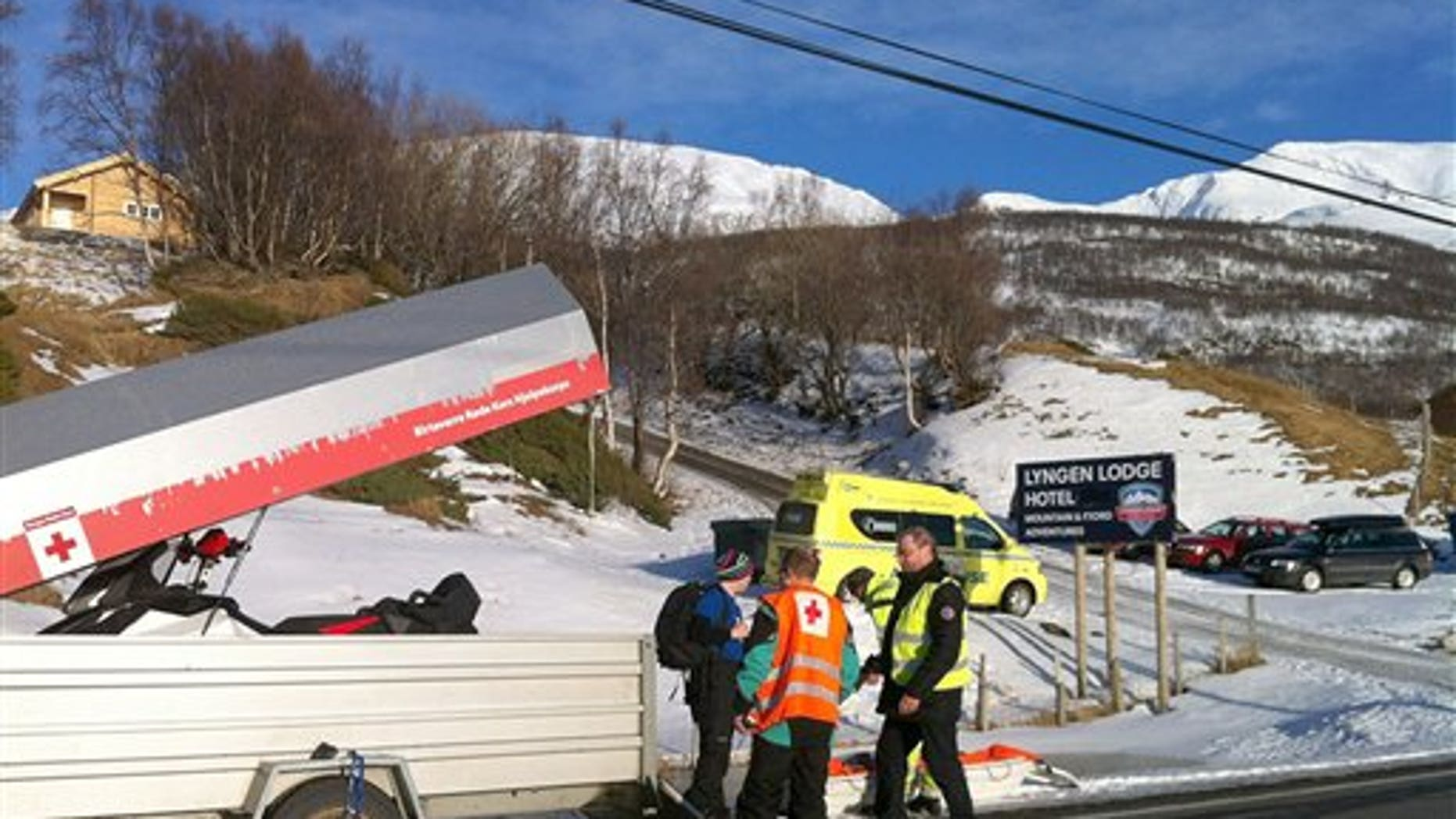 March 19: Rescue personnel prepare to go to the mountain area near Kafjord, Norway where an avalanche is reported to have buried six tourists.