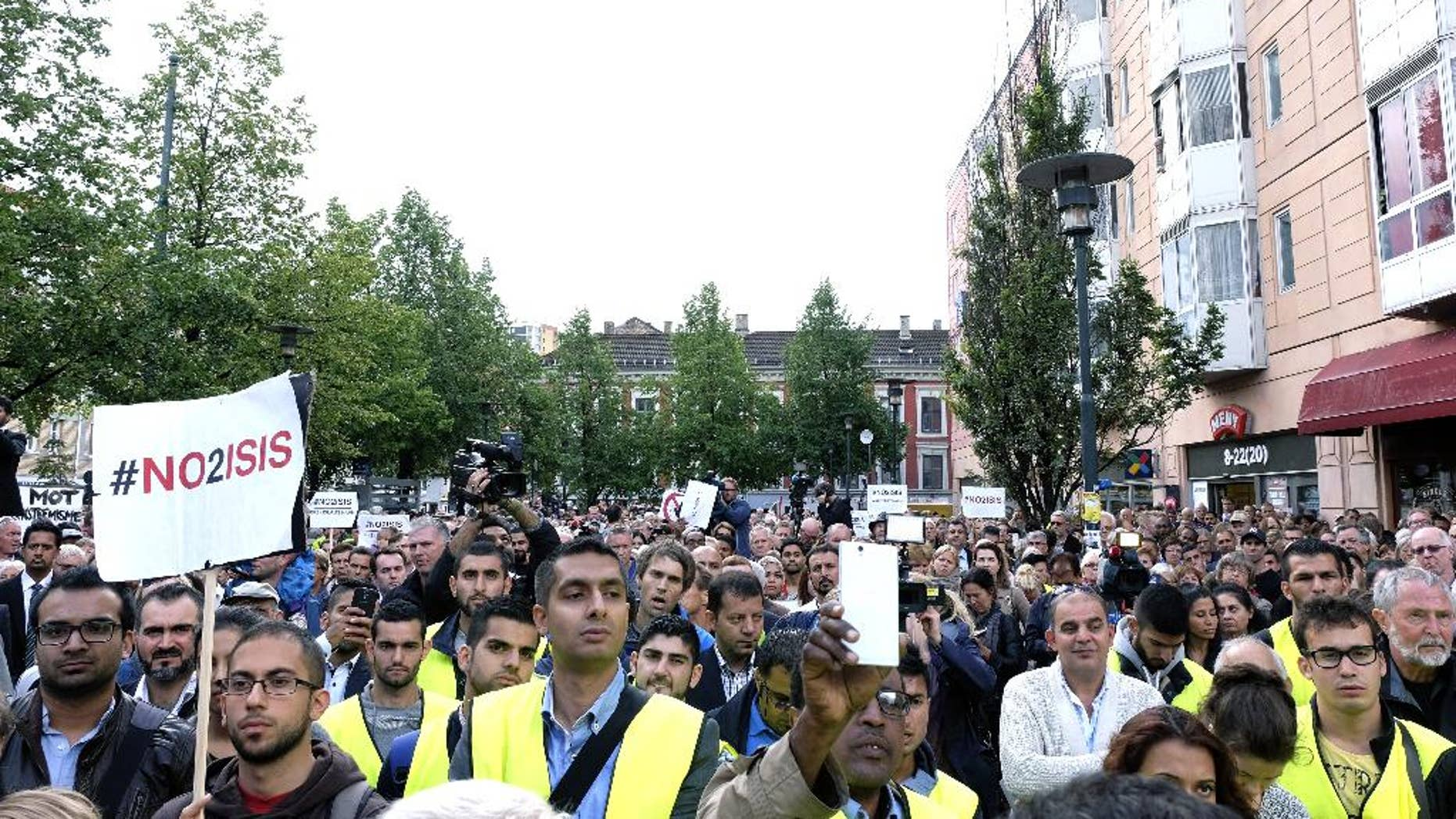 Some of the almost 5,000 protestors attending a demonstration against ISIS, in Oslo, Monday, Aug. 25, 2014. Different Muslim groups were behind the initiative which was attended by political and Muslim leaders. ISIS is an acronym for the Islamic State group. (AP Photo/NTB Scanpix, Torstein Boe) NORWAY OUT