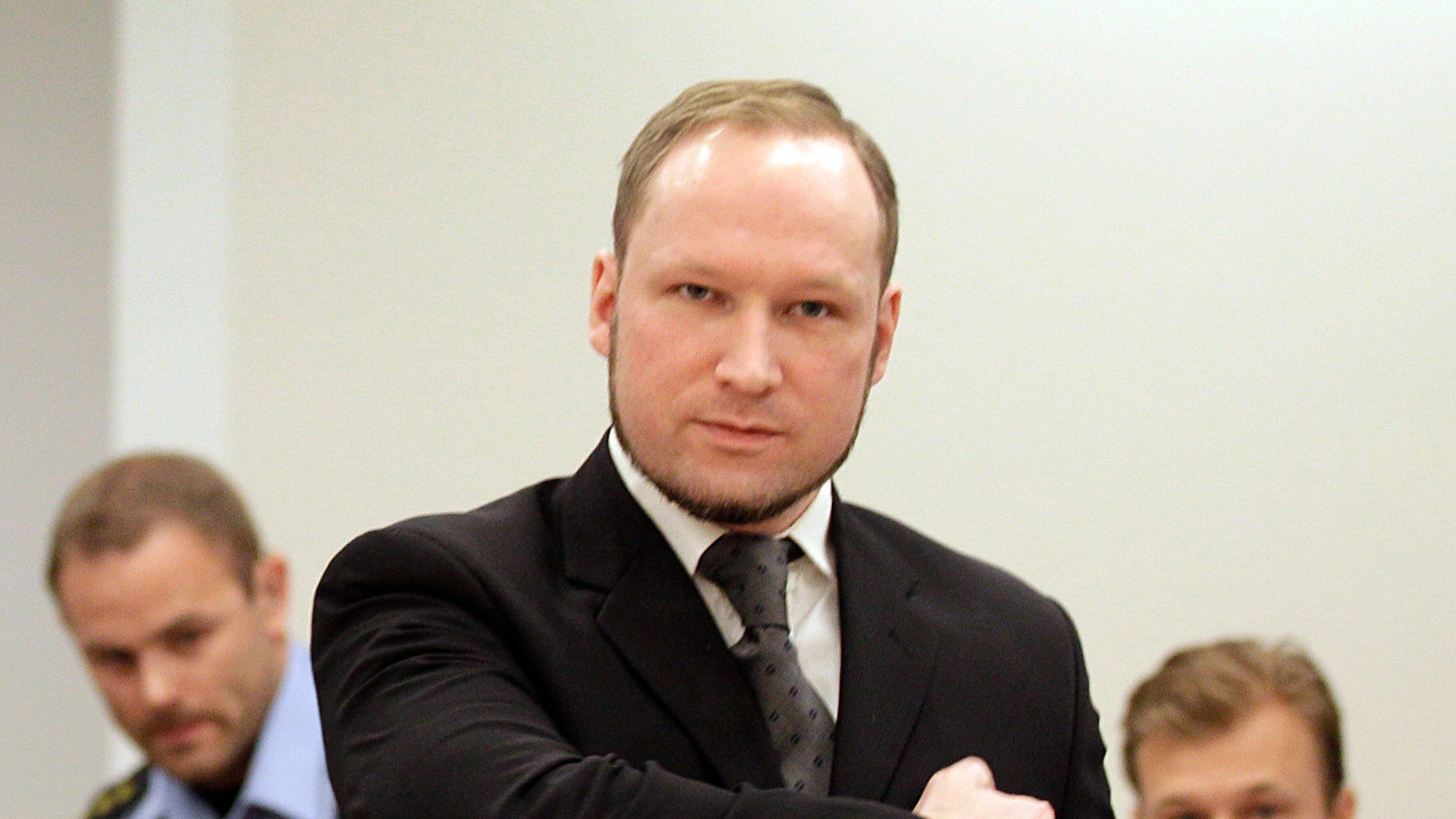 Aug. 24, 2012: Norwegian Anders Behring Breivik gestures as he arrives at the courtroom in Oslo, Norway. Anders Behring Breivik has been declared sane and sentenced to prison for bomb and gun attacks that killed 77 people last year.