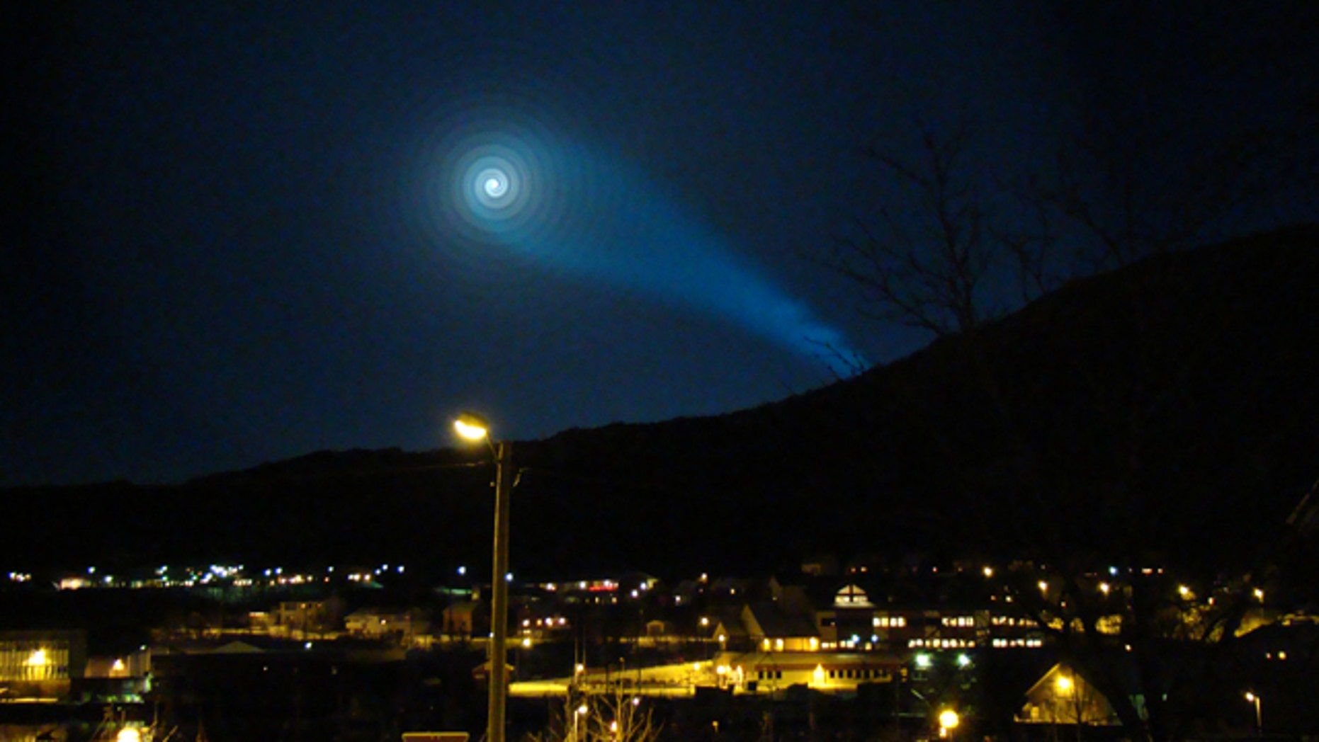 A strange light phenomenon is seen in the night sky above Skjervoy in northern Norway early Wednesday Dec. 9, 2009. According to some reports, the unexplained light may have been caused by the failure of a new Russian anti-submarine-based intercontinental missile which was being tested across the Norwegian-Russian border.