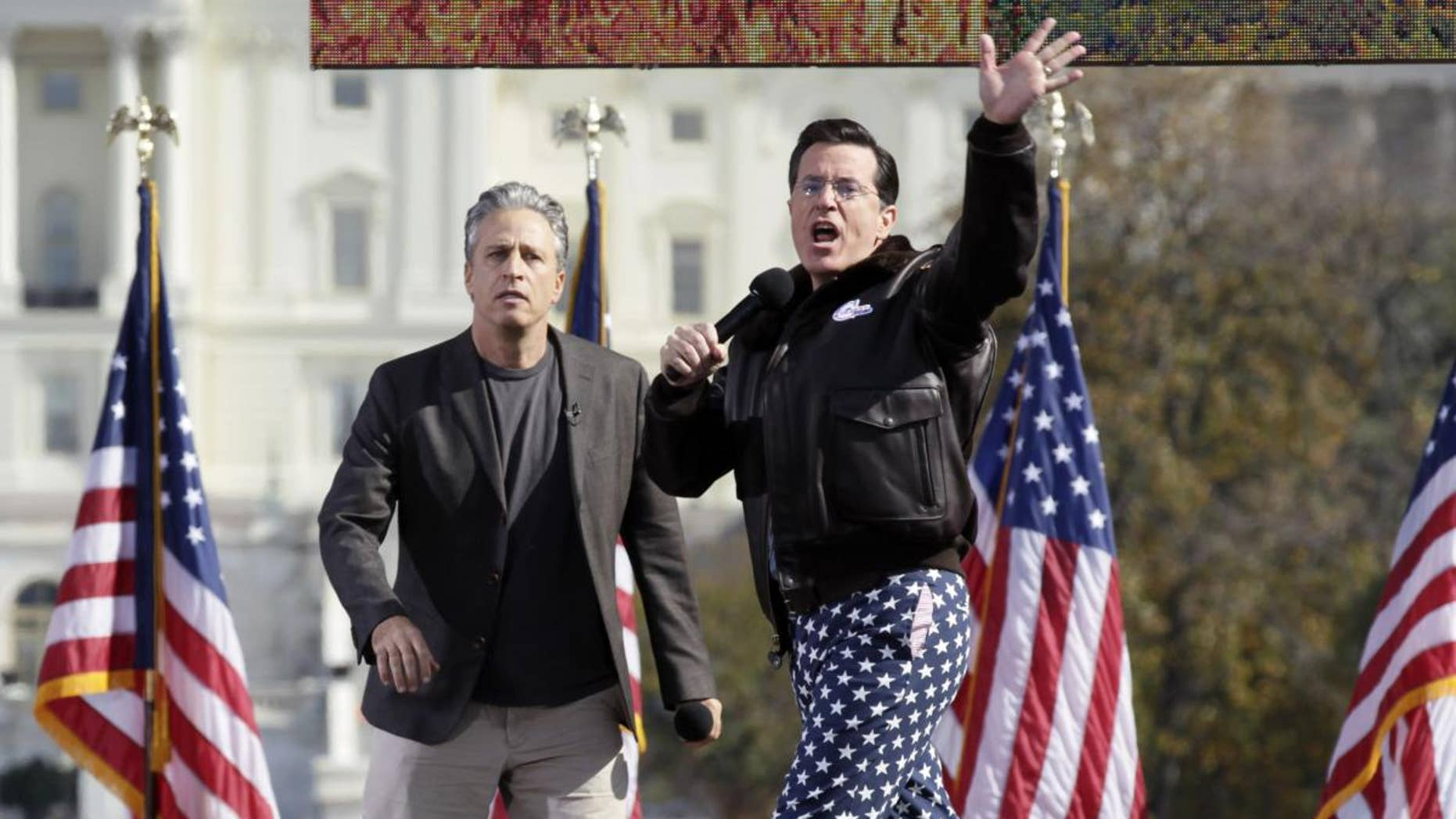John Stewart and Stephen Colbert at Restoring Sanity and/or Fear Rally Sunday/AP photo
