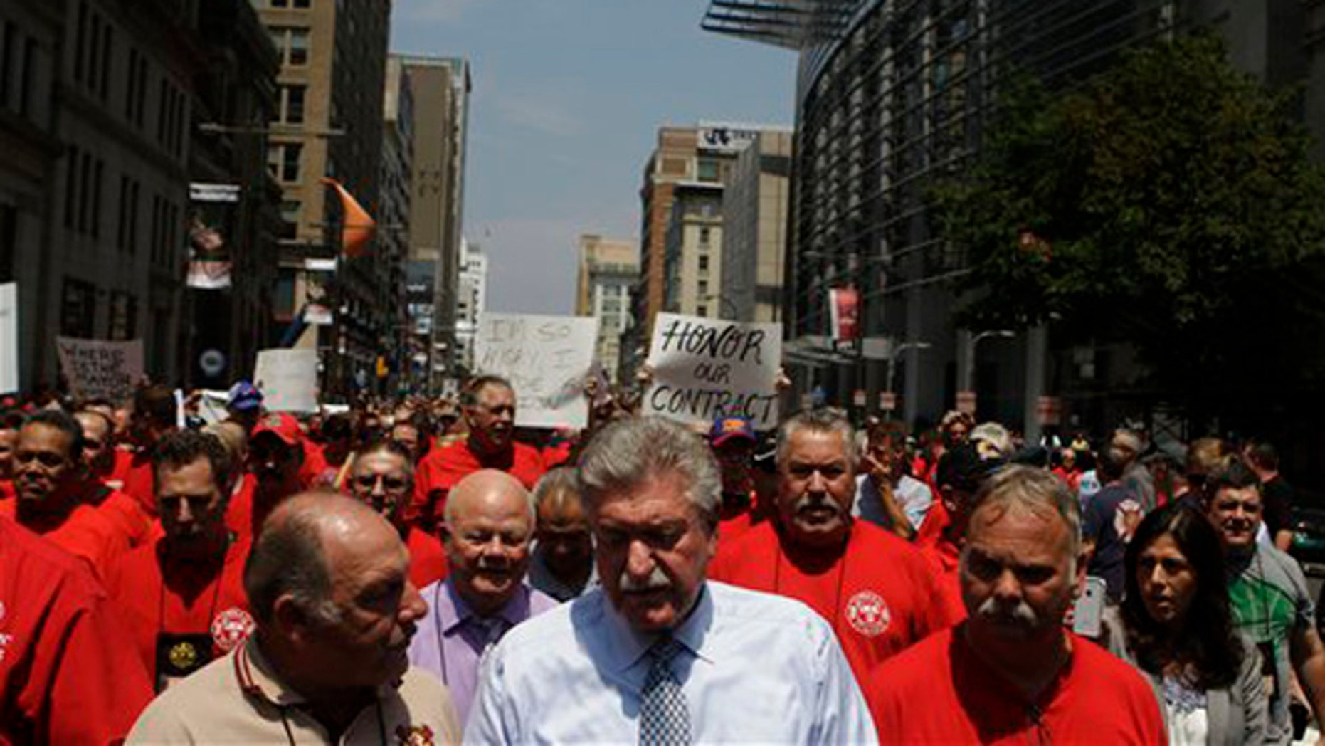 July 26, 2012: Firefighters assemble with Harold Schaitberger of the International Association of Fire Fighters and march to City Hall in Philadelphia.