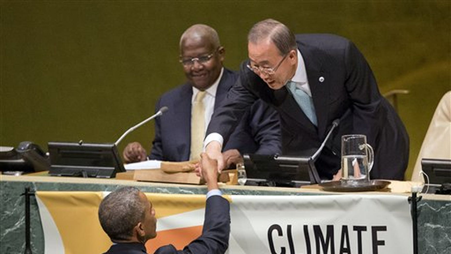 US President Barack Obama, left, is greeted by United Nations Secretary-General Ban Ki-moon, right, before speaking at the Climate Summit 2014 at the UN General Assembly Hall, Tuesday, Sept. 23, 2014. Obama is in New York for three days of talks with foreign leaders at the annual United Nations General Assembly. (AP Photo/Pablo Martinez Monsivais)