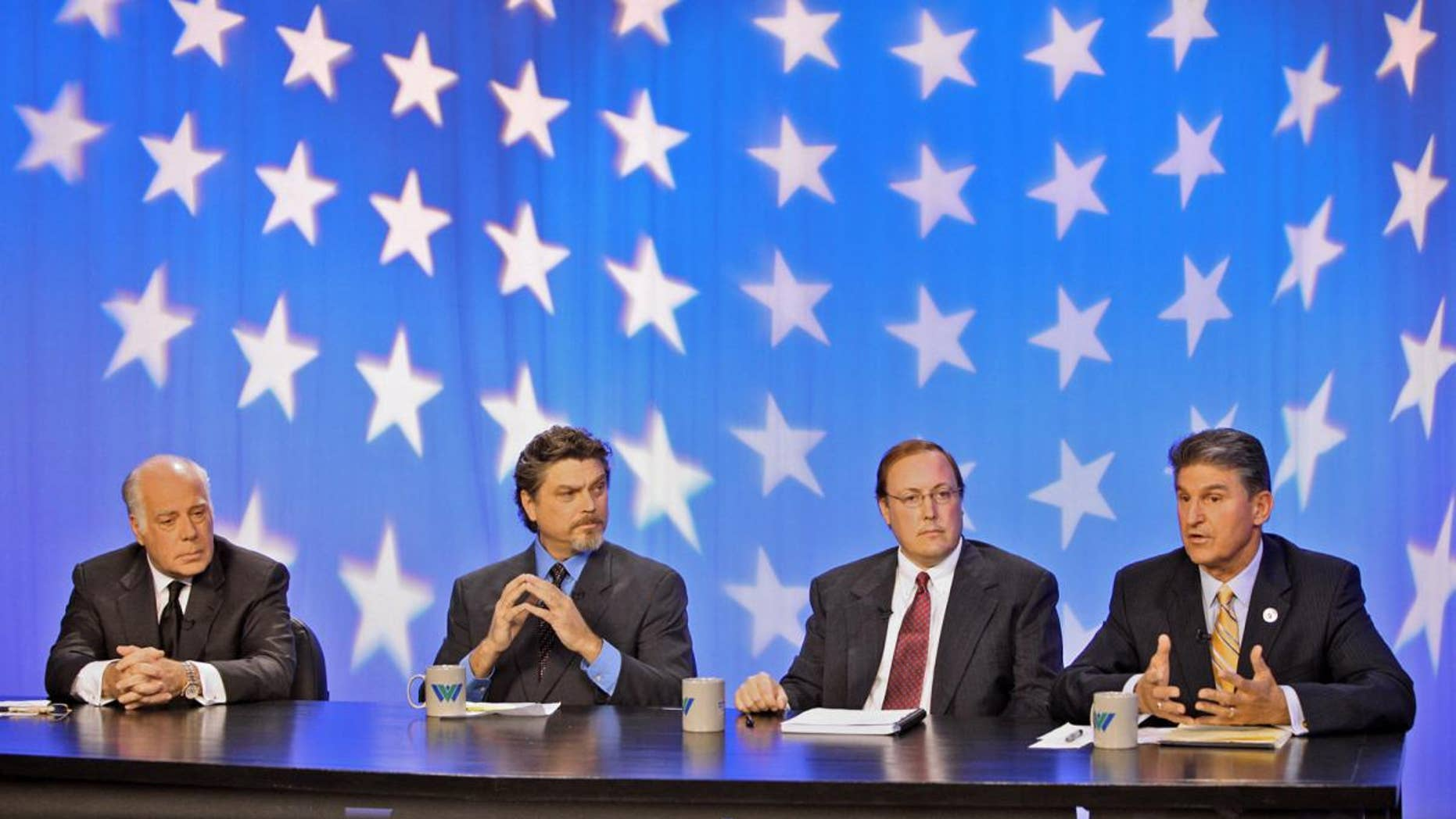 West Virginia senatorial candidates Republican John Raese, Mountain Party candidate Jesse Johnson, and Constitutional Party candidate Jeff Becker, in Morgantown, W.Va. on Monday, Oct. 18, 2010/AP Photo