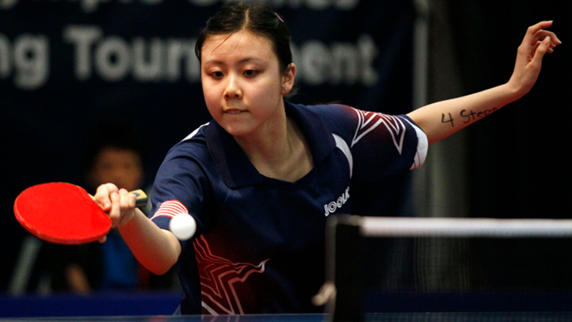 April 20, 2012: This Friday file photo shows United States' Ariel Hsing with her eye on the ball against Canada's Chris Xu during the final women's singles match of the North America Olympic Games table tennis qualifying tournament in Cary, N.C.