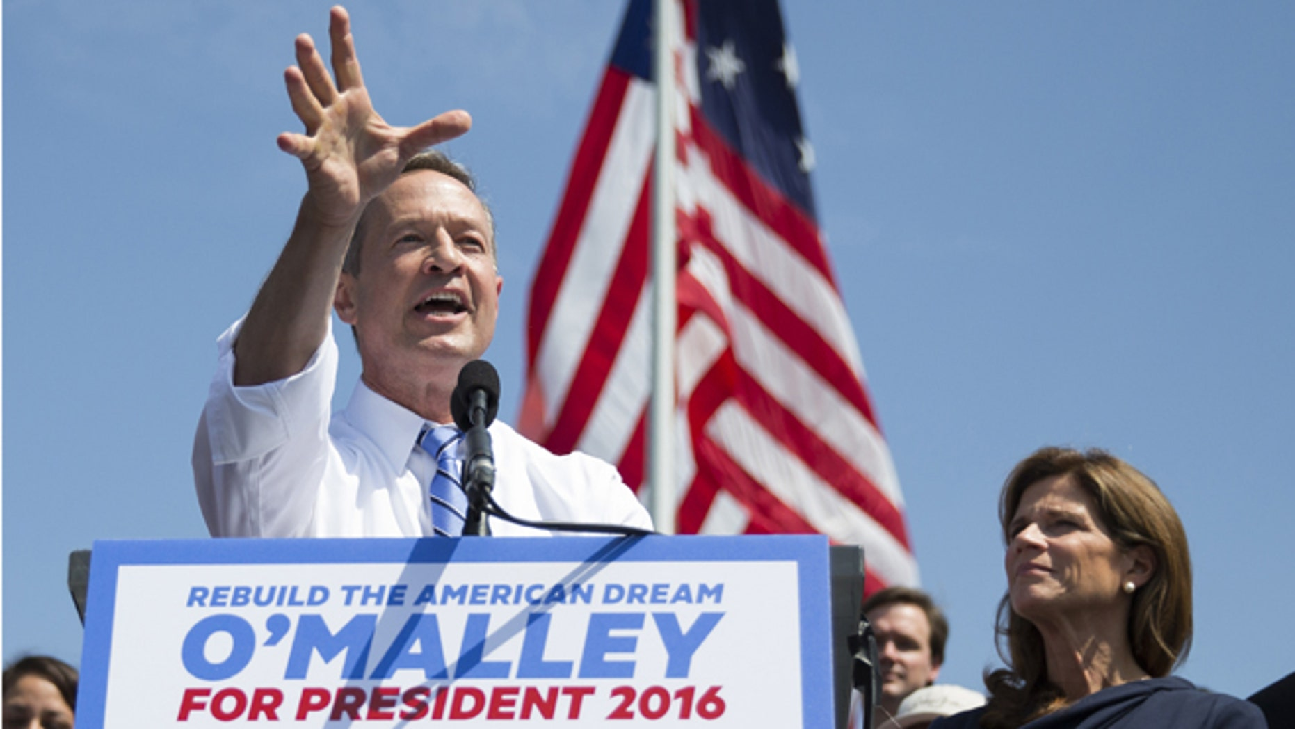 """Former Maryland Gov. Martin O'Malley speaks during an event to announce that he is entering the Democratic presidential race, on Saturday, May 30, 2015, in Baltimore, as his wife Katie, right, looks on.   O'Malley joined the Democratic presidential race with a longshot challenge to Hillary Rodham Clinton for the 2016 nomination.  """"I'm running for you,"""" he told a crowd of about 1,000 people at Federal Hill Park in Baltimore, where he served as mayor before two terms as governor.  (AP Photo/Evan Vucci)"""