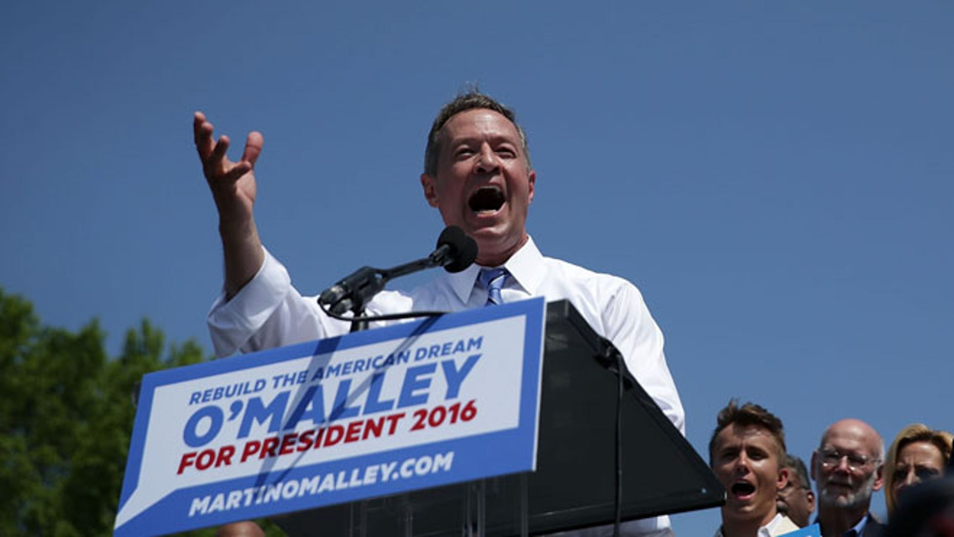 BALTIMORE, MD - MAY 30:  Former Maryland Gov. Martin O'Malley speaks as his wife Katie listens during an event to announce his candidacy for a presidential campaign May 30, 2015 at Federal Hill Park in Baltimore, Maryland. O'Malley was the third Democrat, after former U.S. Secretary of State Hillary Clinton and Sen. Bernie Sanders (I-VT), to throw his hat in the ring for the Democratic nomination.  (Photo by Alex Wong/Getty Images)