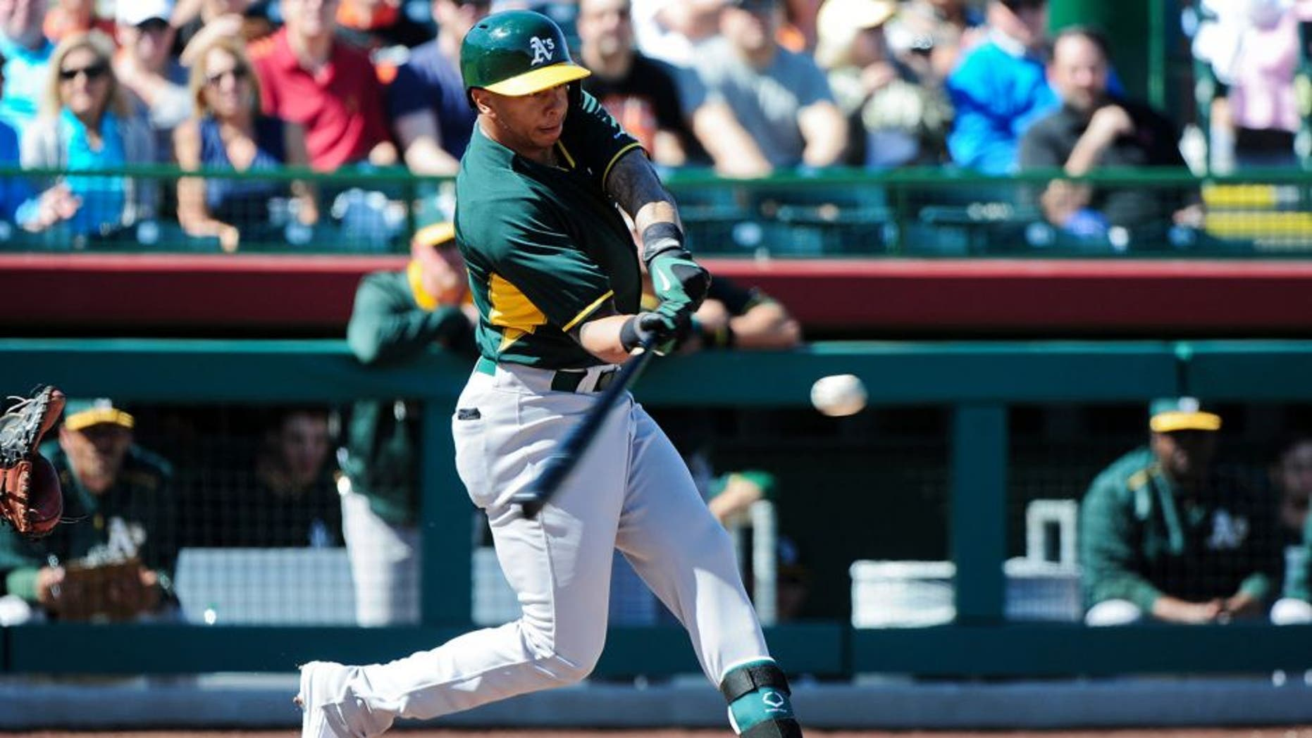 Mar 4, 2015; Scottsdale, AZ, USA; Oakland Athletics second baseman Tyler Ladendorf (25) flies out during the first inning against the San Francisco Giants during a spring training baseball game at Scottsdale Stadium. Mandatory Credit: Matt Kartozian-USA TODAY Sports