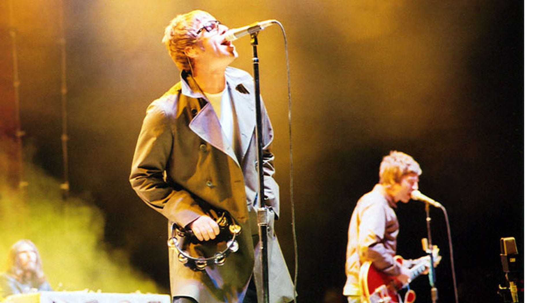 Vocalist Liam Gallagher, guitarist Noel Gallagher and, keyboardist Jay Darlington in background in 2005.