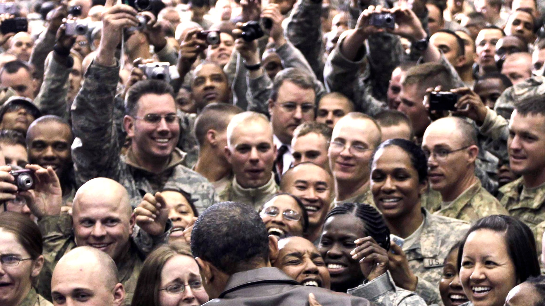 Dec. 3: Obama greets troops at a rally during an unannounced visit at Bagram Air Field in Afghanistan.