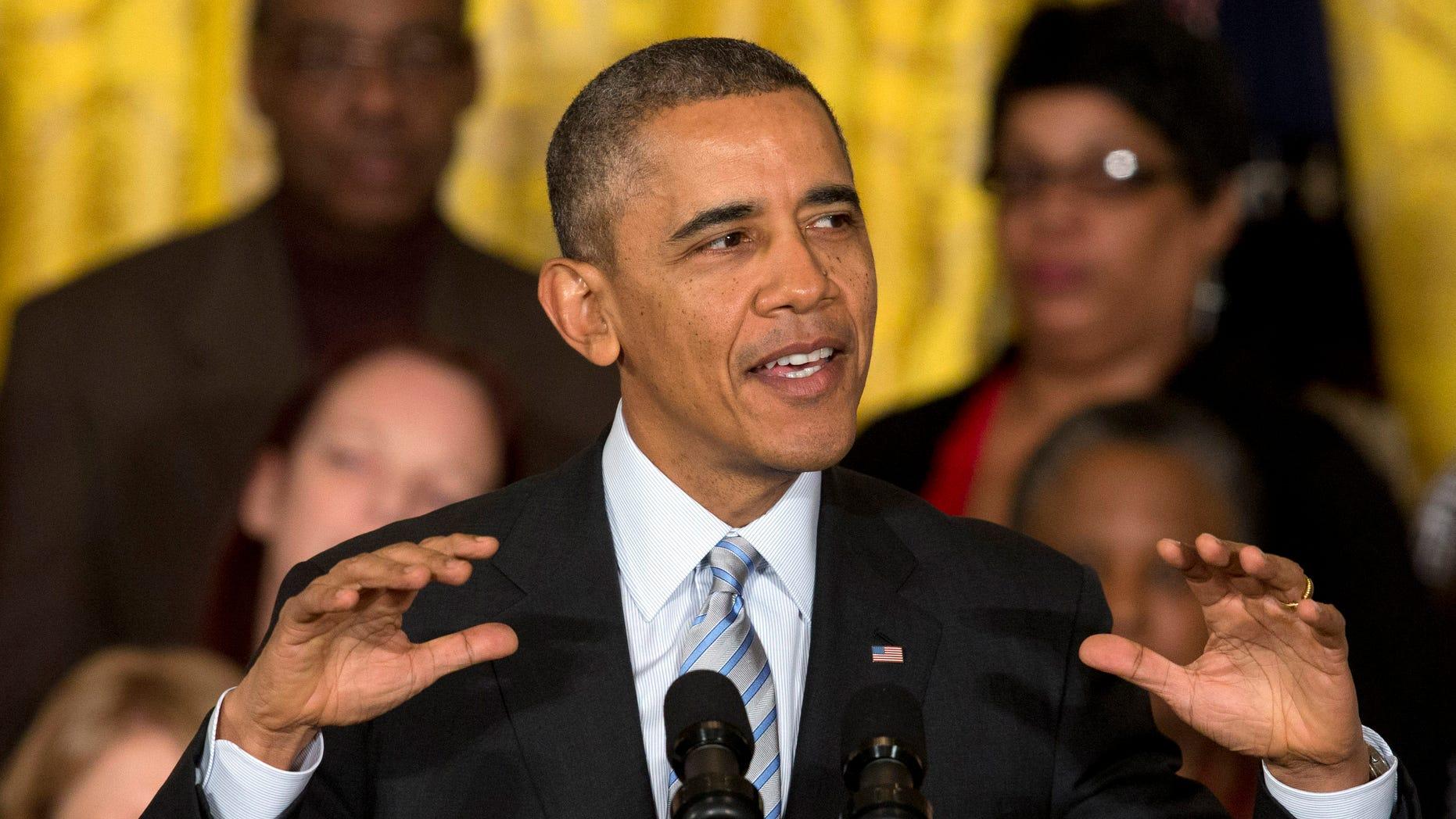 Feb. 12, 2014 President Obama speaks in the East Room of the White House.