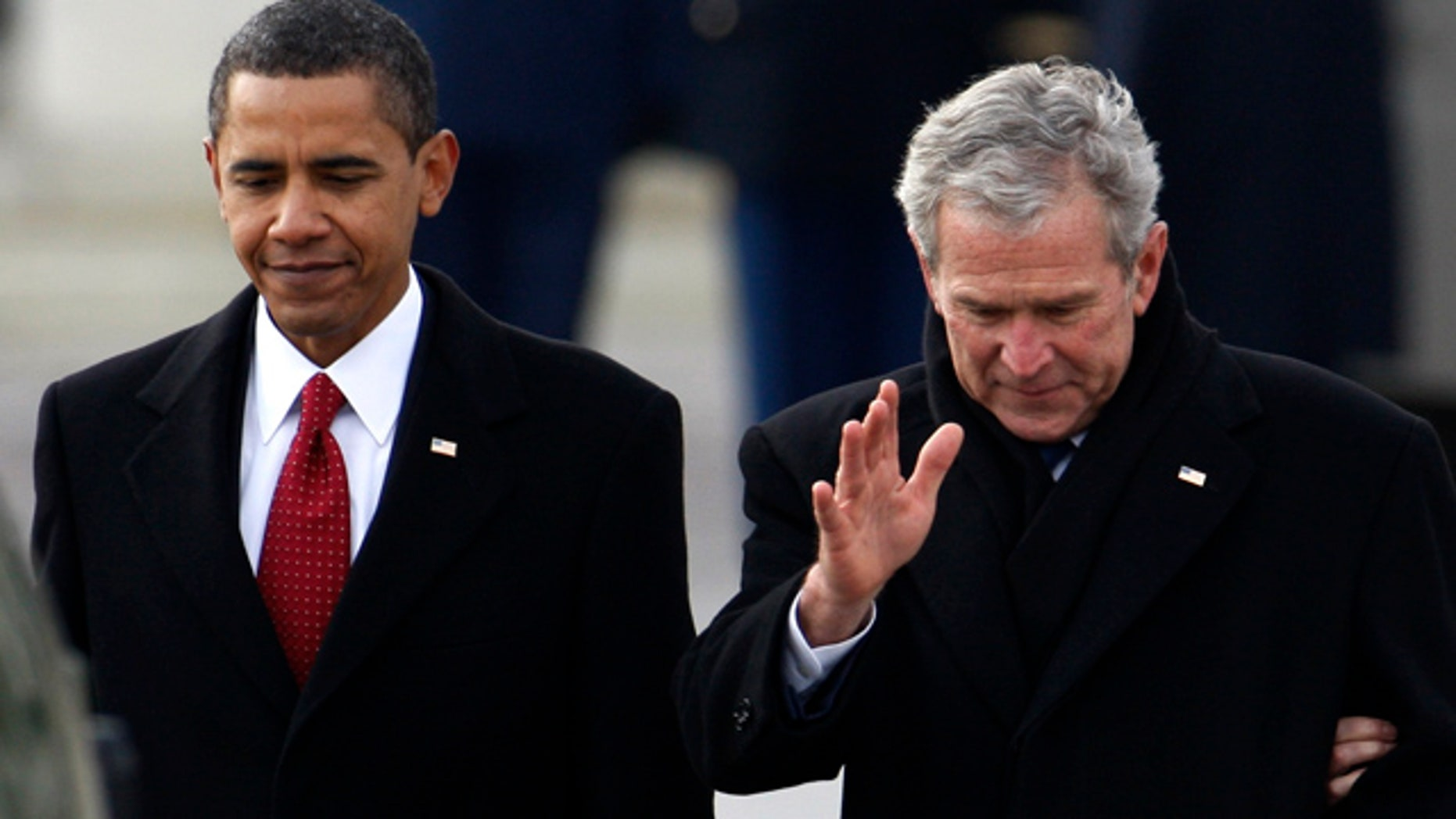 Jan. 20, 2009: President Obama escorts former President Bush to a waiting helicopter behind the U.S. Capitol after Obama's inauguration ceremony in Washington.