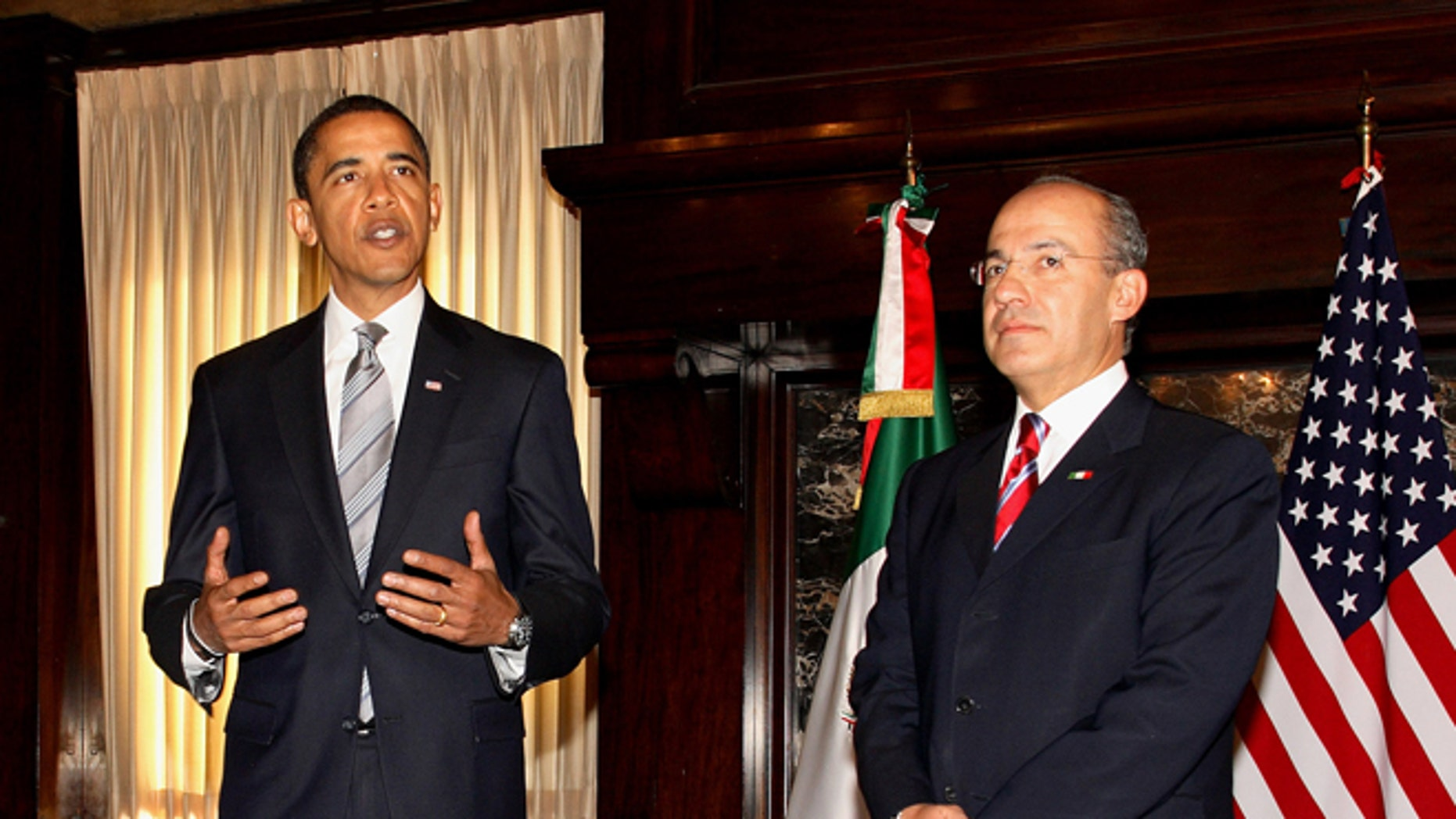 WASHINGTON - JANUARY 12: U.S. President-elect Barack Obama (L) meets with Mexican President Felipe Calderon at the Mexican Cultural Institute January 12, 2009 in Washington, DC. Calderon met with Obama eight days before he is to be inaugurated, and is to meet with U.S. President George W. Bush tomorrow.  (Photo by Martin H. Simon-Pool/Getty Images)