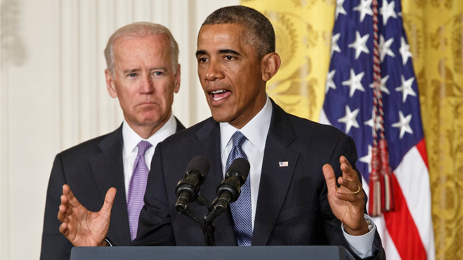 In this Friday, Sept. 19, 2014 photo, President Obama, with Vice President Biden, left, outlines the 'It's On Us' campaign to help colleges and universities to prevent and respond to sexual assault on campus, at the White House in Washington.