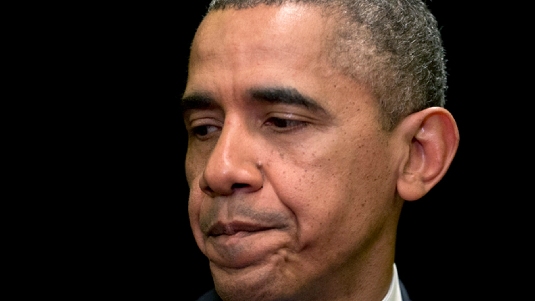 April 2, 2014: President Barack Obama pauses as he speaks about the shooting at Fort Hood in Chicago. (AP Photo/Carolyn Kaster)