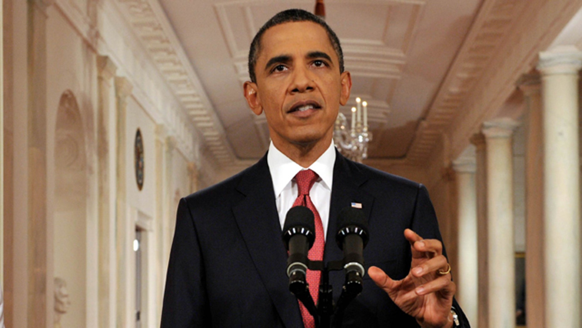President Obama, shown here July 25, and top auto executives are set to unveil details of a compromise to slash the amount of gasoline cars and trucks will need down the road.