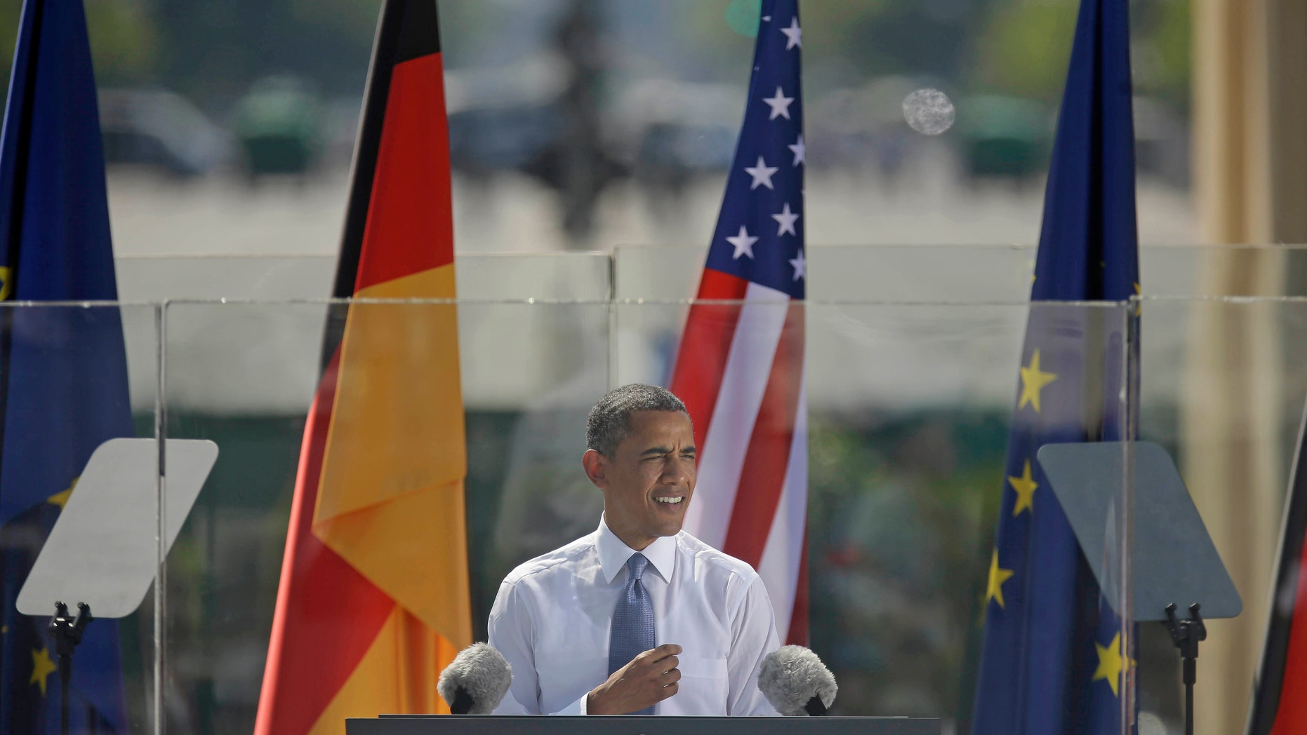 """President Barack Obama speaks in front of the iconic Brandenburg Gate in Berlin Germany, Wednesday, June 19, 2013. Obama is planning a major push using executive powers to tackle the pollution blamed for global warming in an effort to make good on promises he made at the start of his second term. """"We know we have to do more  and we will do more,"""" Obama said in Berlin. (AP Photo/Pablo Martinez Monsivais)"""