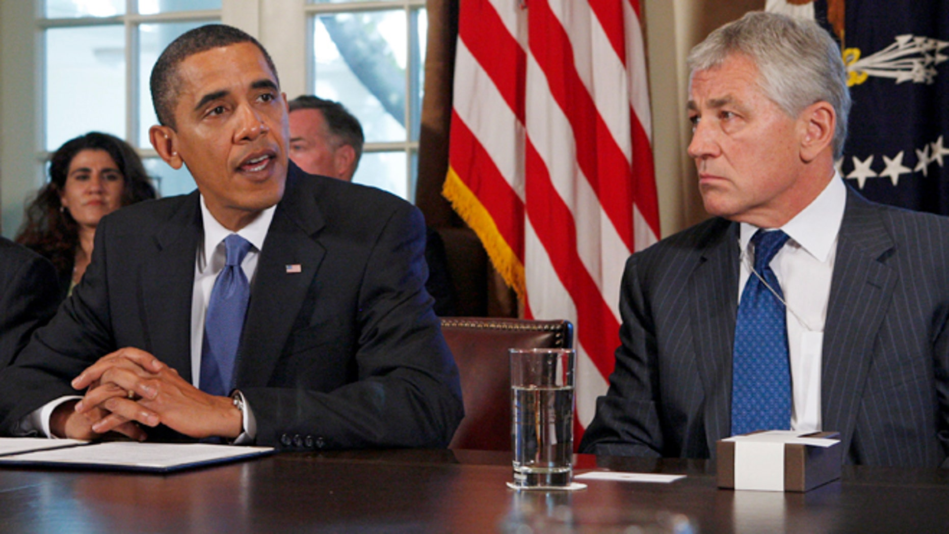President Obama meets with Chuck Hagel, then co-chairman of the president's Intelligence Advisory Board, in this 2009 file photo.