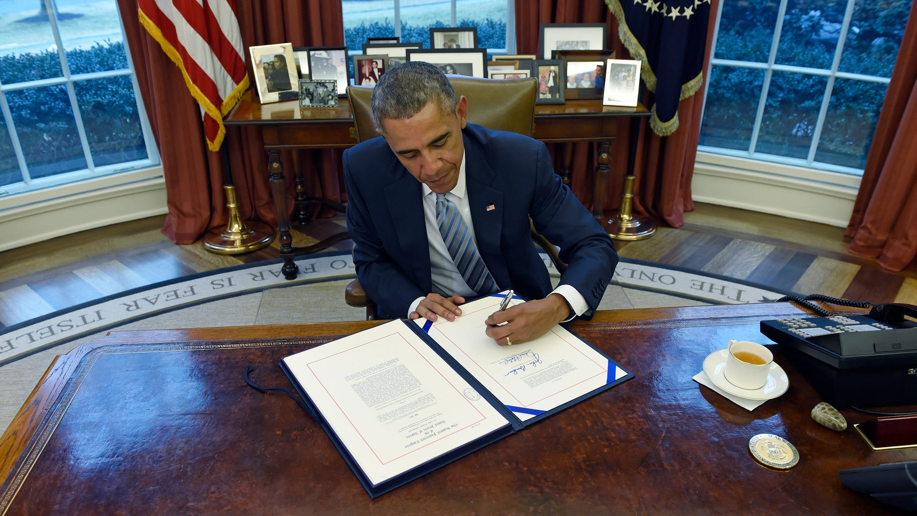 President Obama signs the Department of Homeland Security Appropriations Act on March 4, 2015.