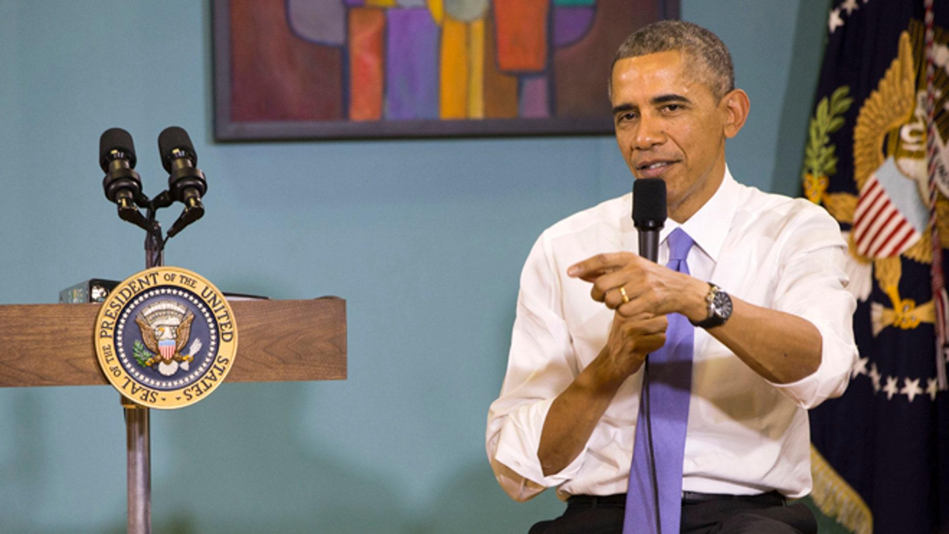 This Tuesday, Dec. 9, 2014 photo shows, President Barack Obama immigration town hall at Casa Azafran in Nashville, Tenn.