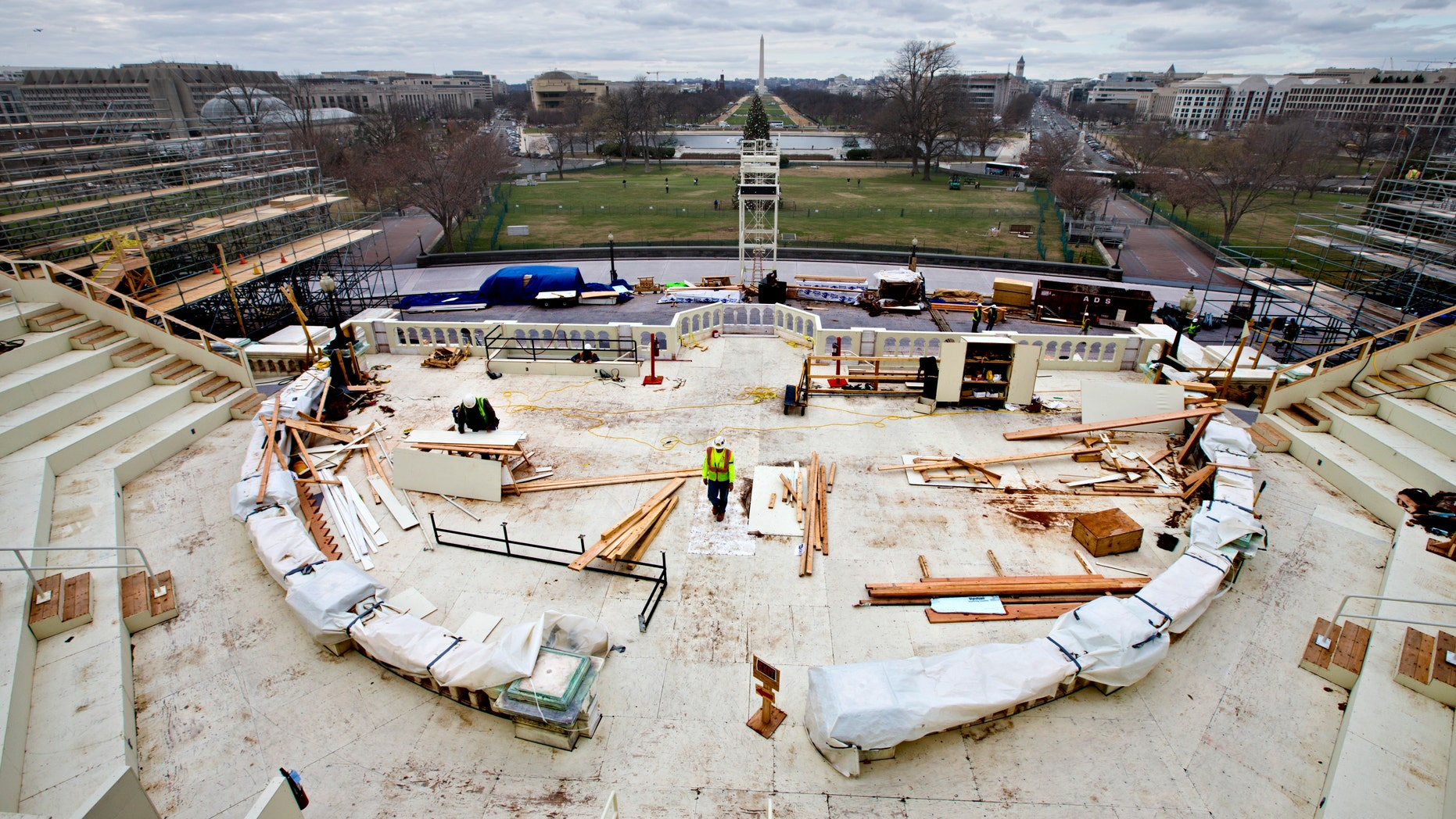 In this Dec. 11, 2012 file photo, construction workers continue work on the platforms on the west side of the Capitol where dignitaries and news cameras will witness the inaugural ceremonies on Capitol Hill in Washington. (AP Photo/J. Scott Applewhite, File)