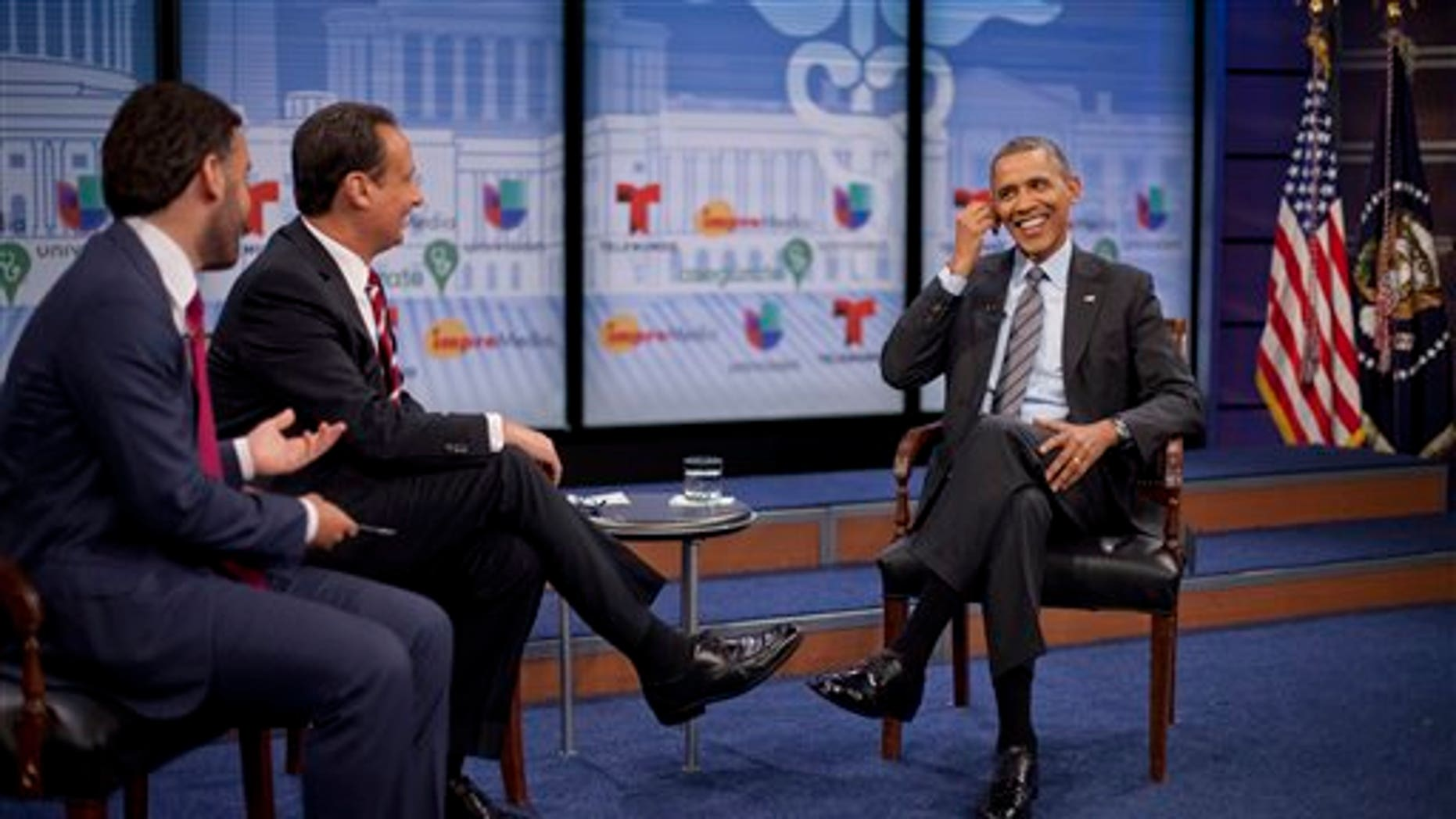 President Obama with television hosts Jose Diaz Balart and Enrique Acevedo, in Washington, Thursday, March 6, 2014.