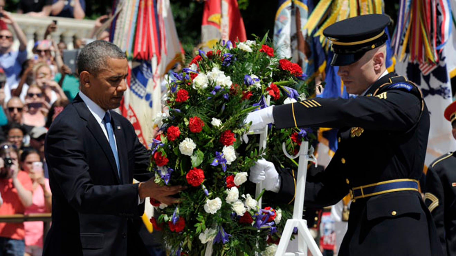 President Obama lays a wreath at the Tomb of the Unknowns at Arlington National Cemetery in Arlington, Va.