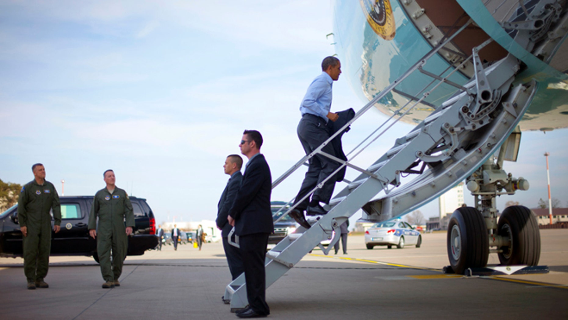 U.S. President Barack Obama boards Air Force One at Ramstein Air Base, Saturday, March 29, 2014, in Germany. Air Force One was making a scheduled refueling stop in Germany and he was using the opportunity to meet with US members of the military. Obama is returning back to Washington after a week long trip aboard to Europe and Saudi Arabia. (AP Photo/Pablo Martinez Monsivais)