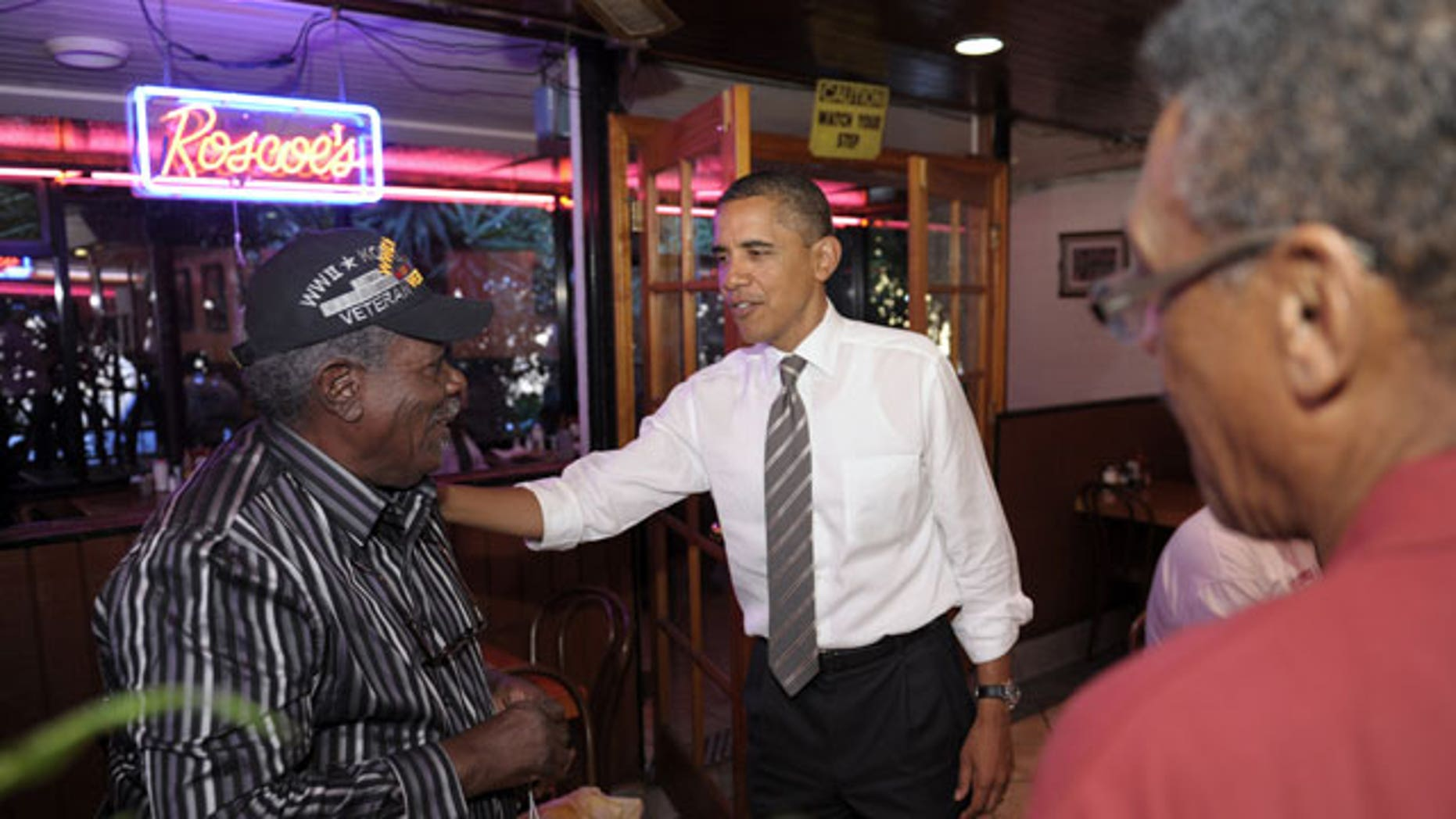 October 24: President Barack Obama greets patrons as he stops for a snack at Roscoe's House of Chicken and Waffles in Los Angeles.