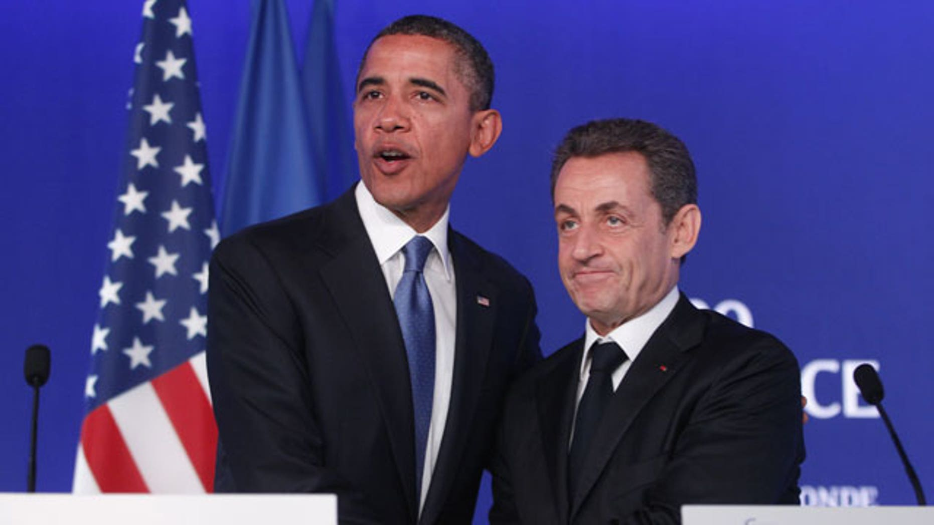 November 3, 2011: U.S. President Barack Obama, left, and French President Nicolas Sarkozy shake hands after they made statements to reporters after their meeting at the G20 Summit in Cannes.