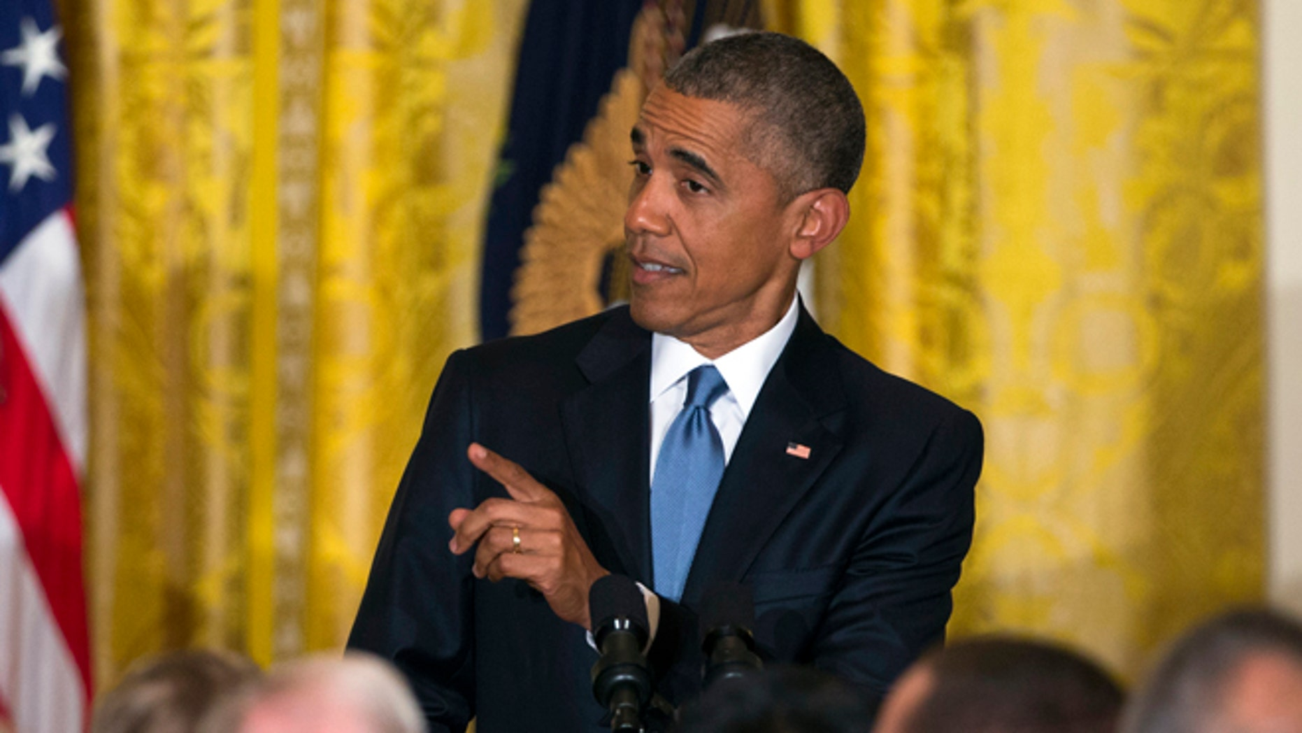 President Barack Obama responds to a heckler as he speaks during a reception to celebrate LGBT Pride Month in the East Room of the White House, on Wednesday, June 24, 2015, in Washington. (AP Photo/Evan Vucci)